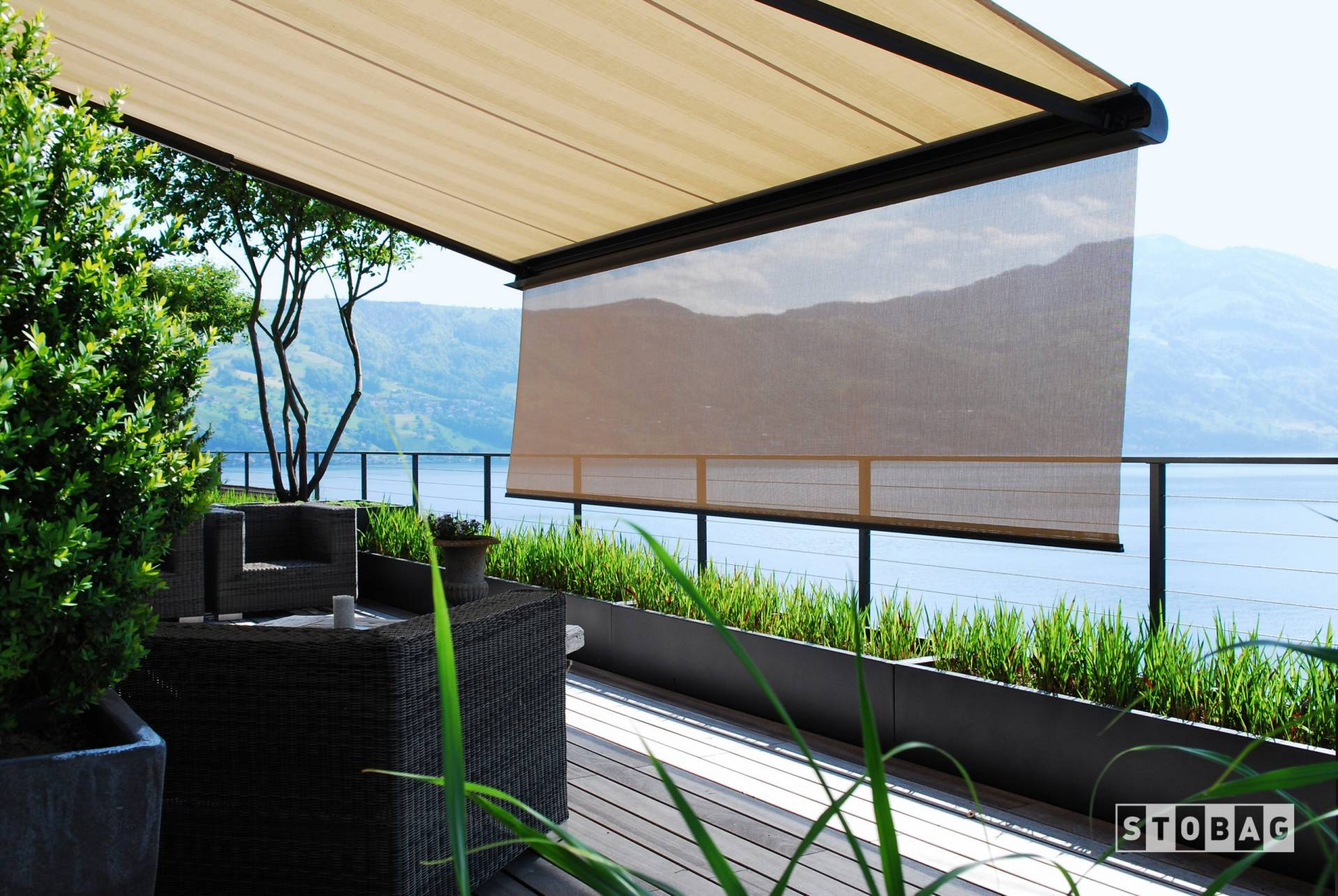 Custom motorized retractable awning with drop down shade