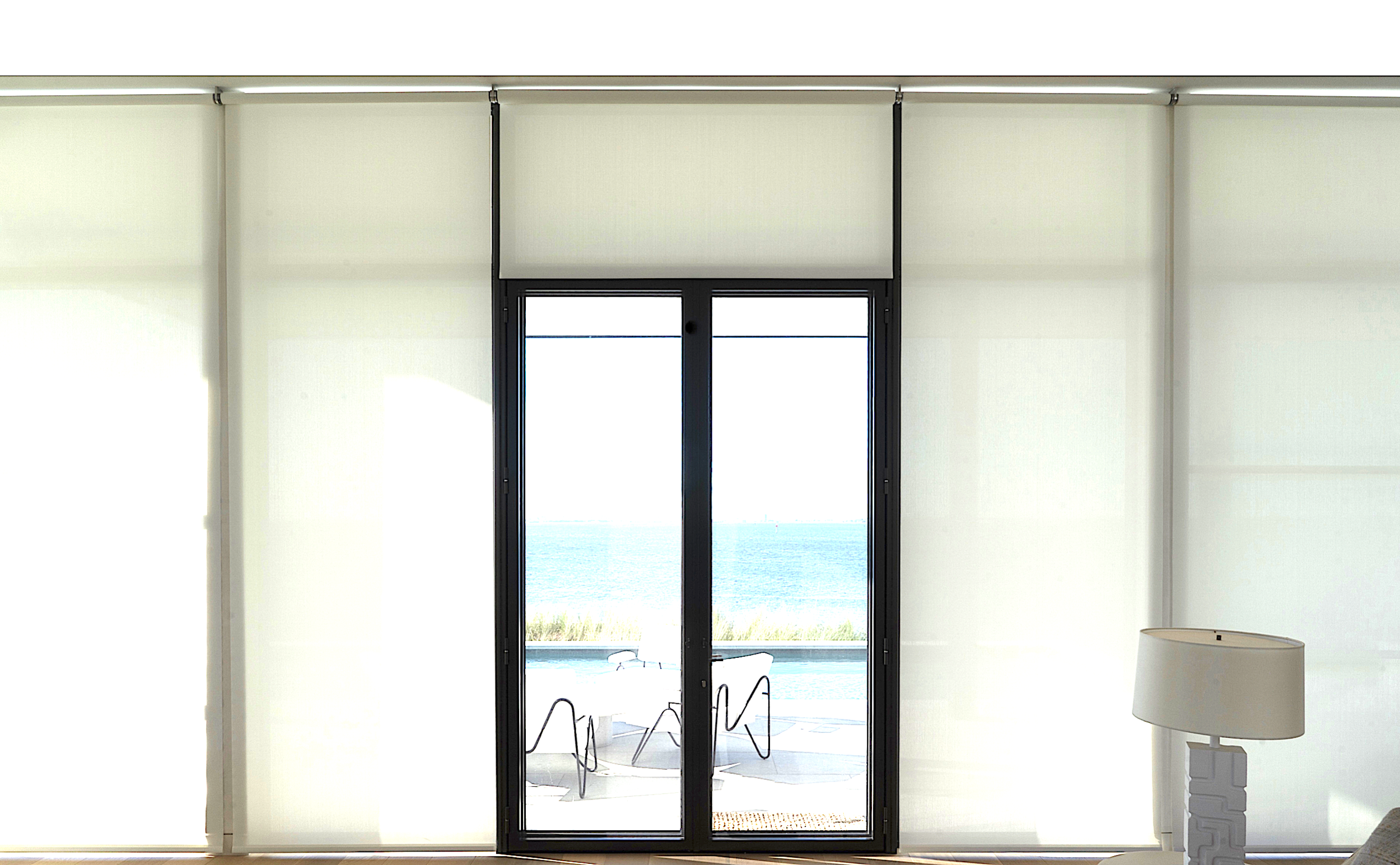 Wall of windows with roller shades