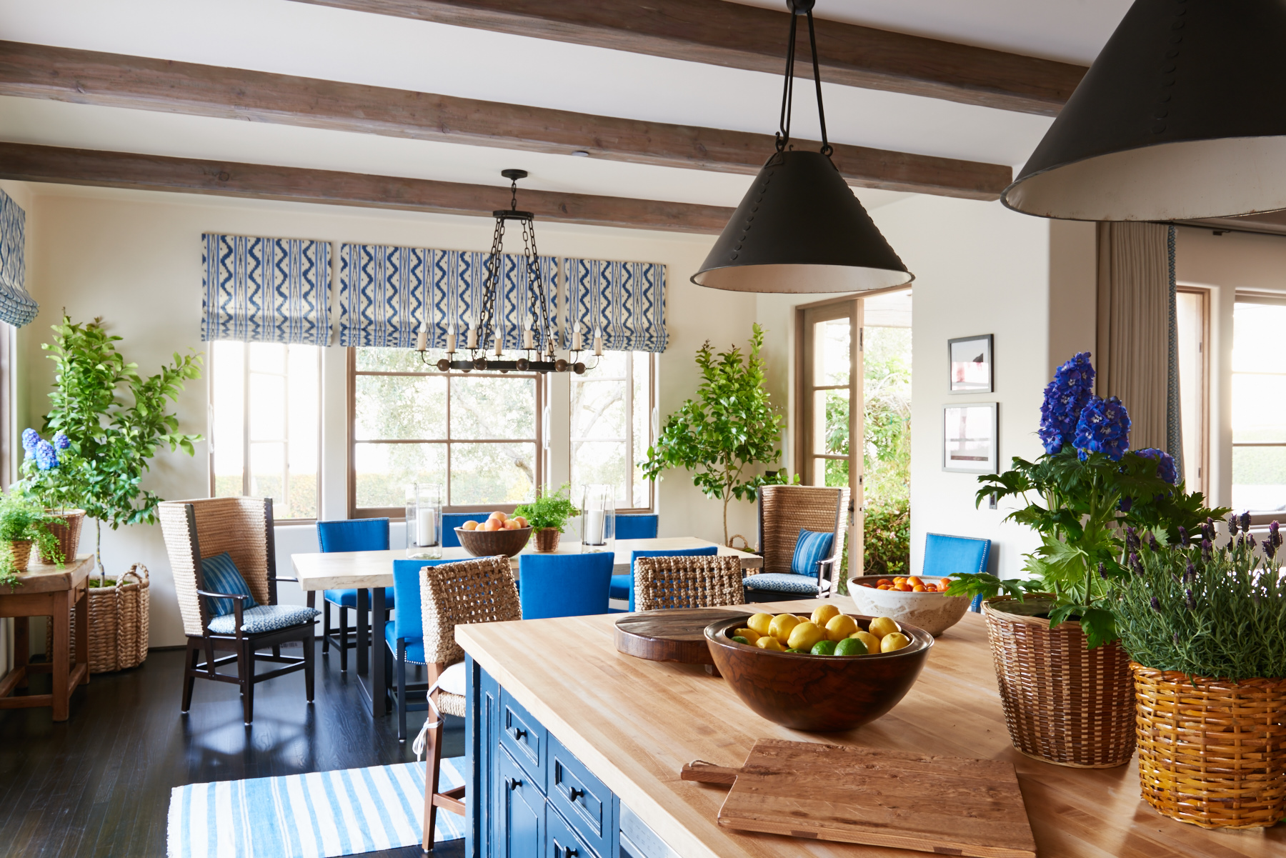 Blue upholstered dining chairs with matching roman shades
