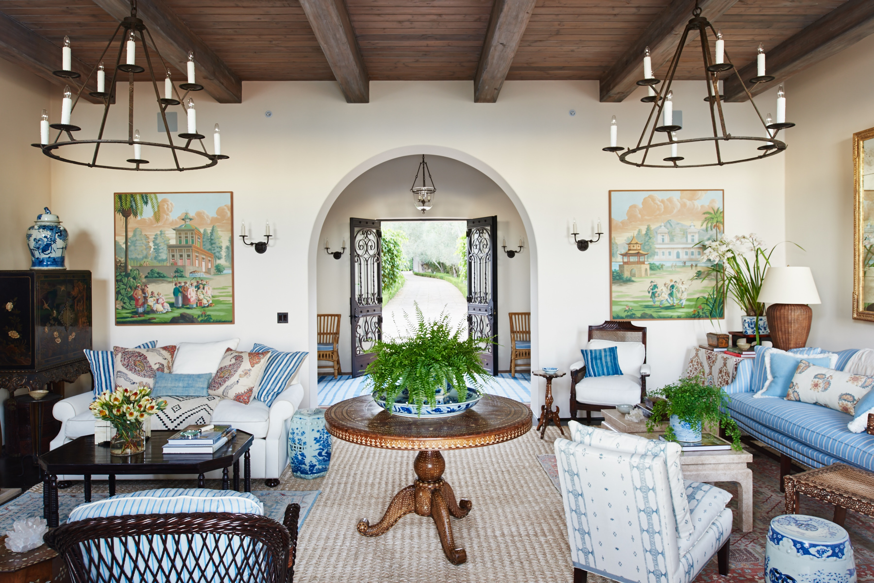 Arched living room with exposed wood ceiling, drapery with custom trim edge and upholstered furniture