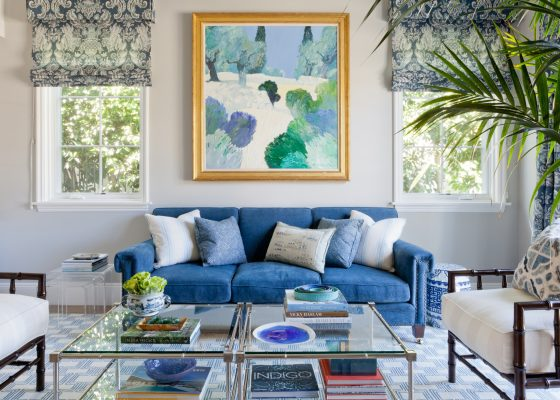 Blue velvet sofa with blue fleur de lis roman shades