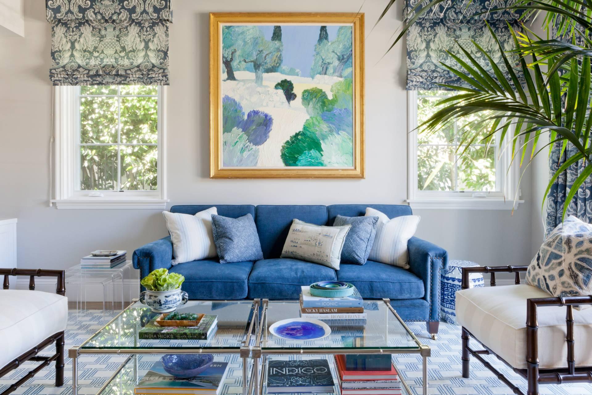 Blue velvet sofa with blue fleur de lis roman shades