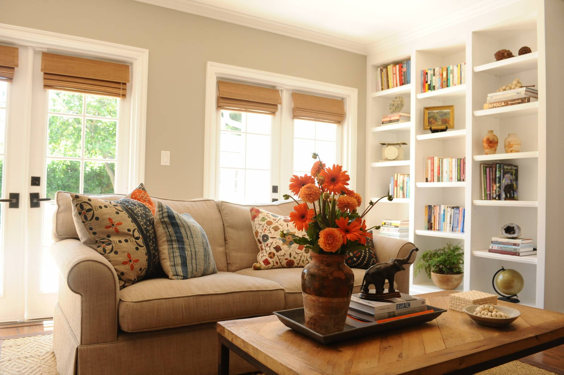 Tan sofa and inside mounted flat woven shades