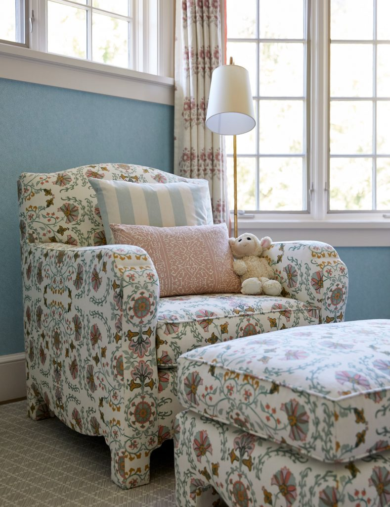 Floral pattern armchair and matching ottoman