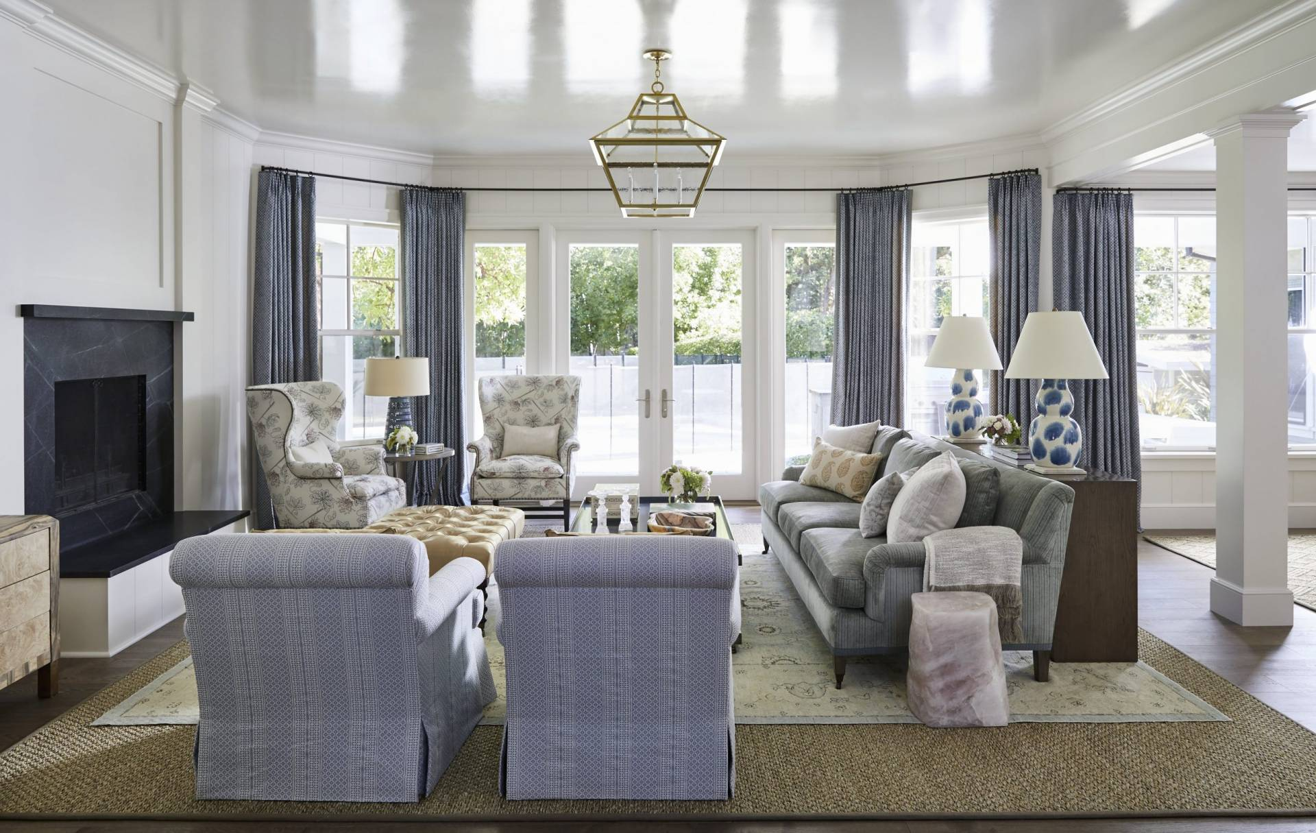 Wide view of living room with multiple style upholstered sofas and chairs