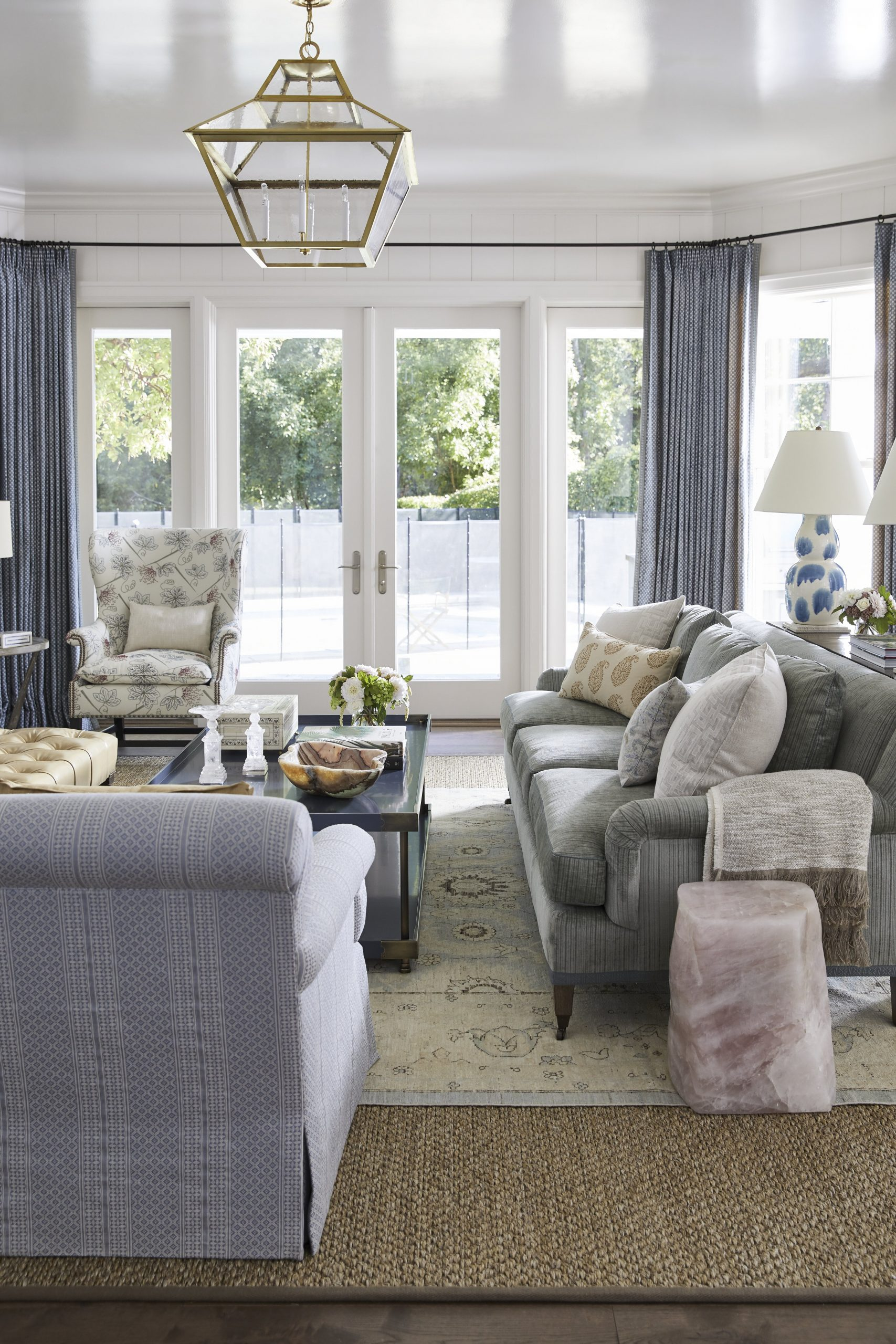 Living room with multiple style upholstered sofas and chairs