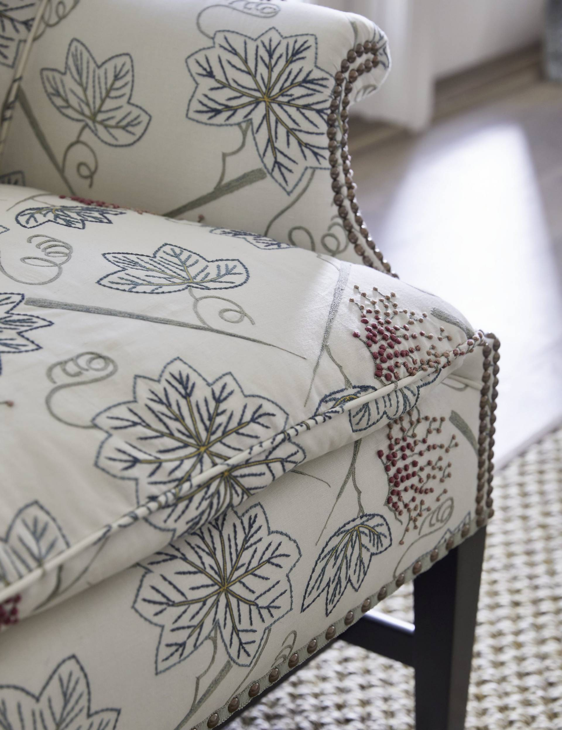 Leaf pattern upholstered armchair with rivets