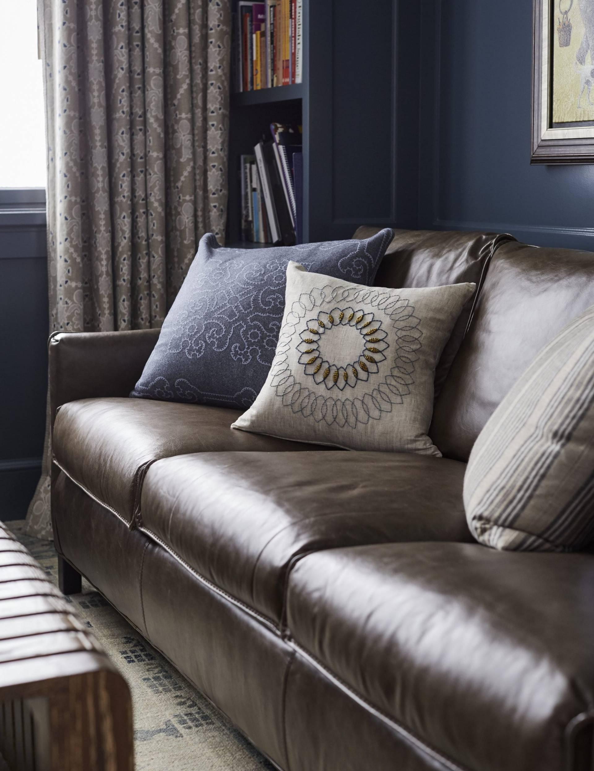 Brown leather sofa and custom throw pillows