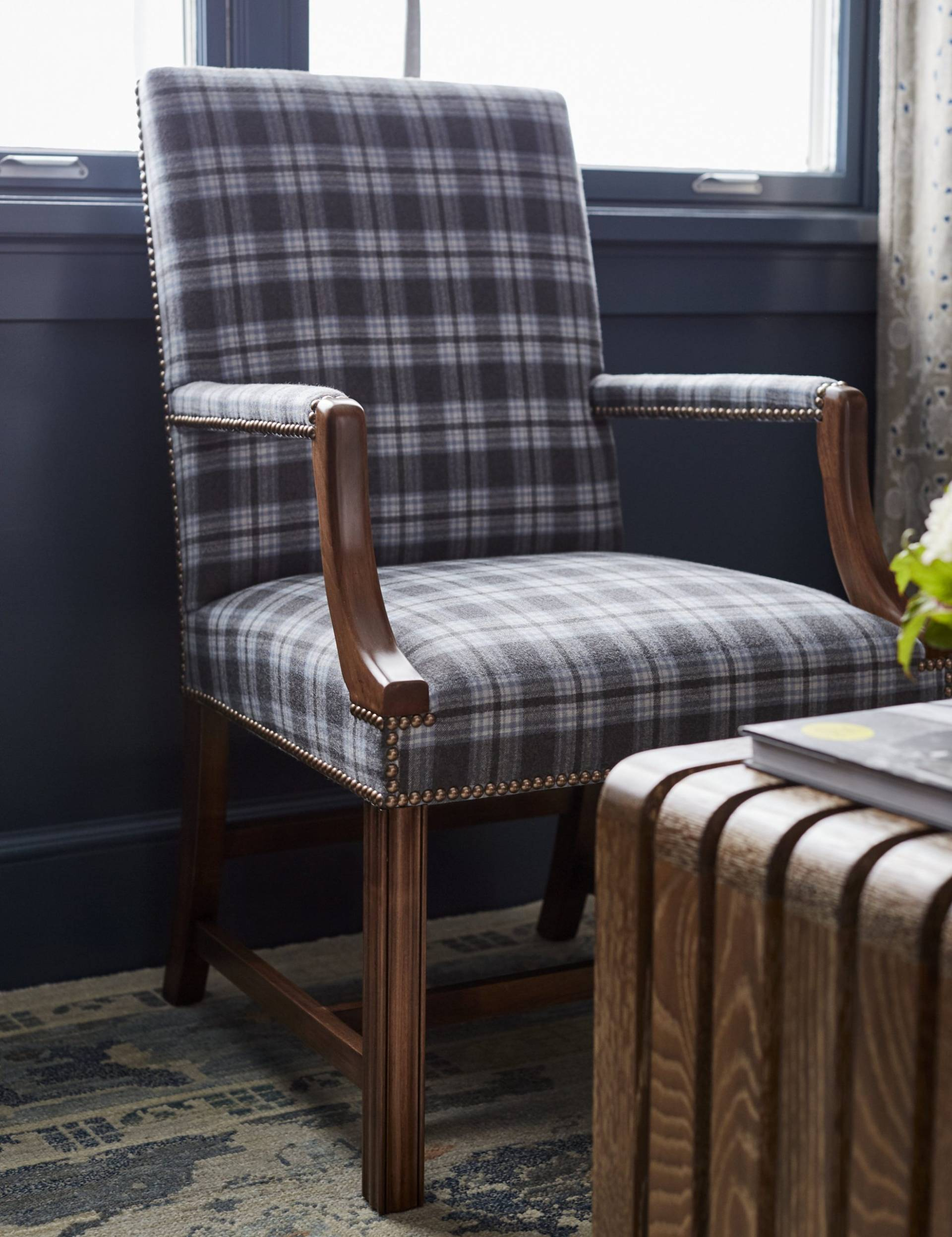 Flannel pattern upholstered armchair with rivets
