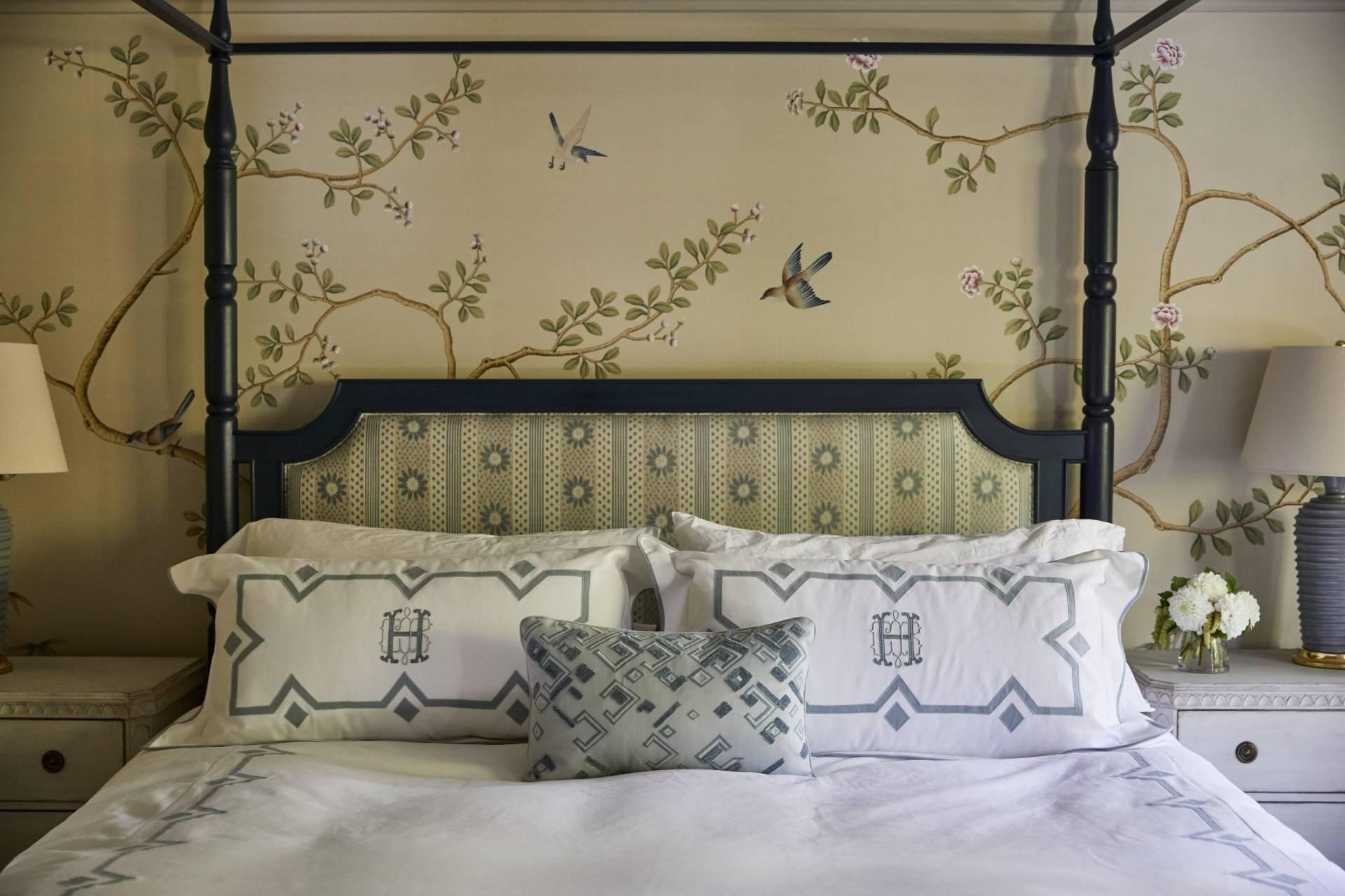 Upholstered headboard, custom bedding, and shams monographed