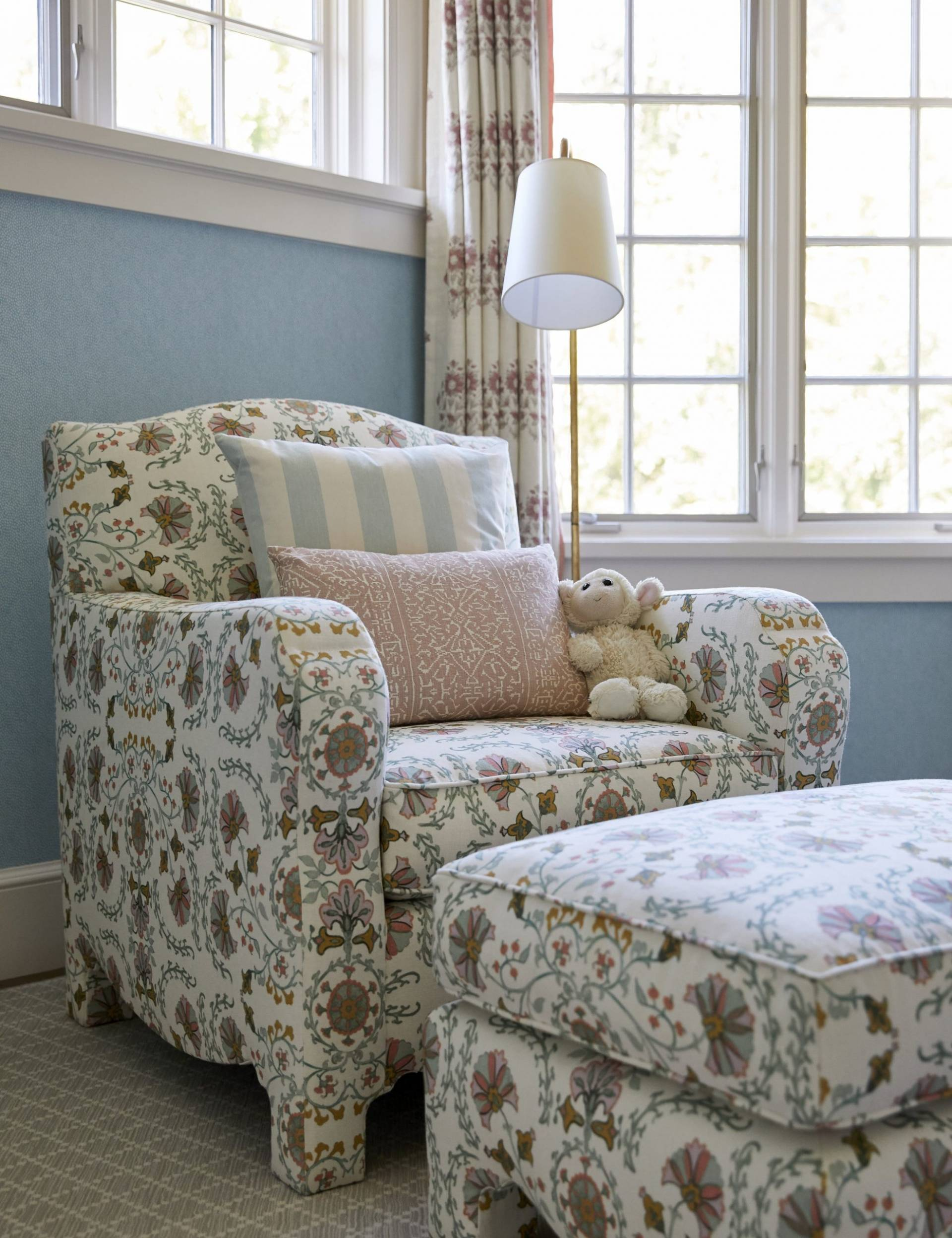 Floral patterned sitting char and drapery