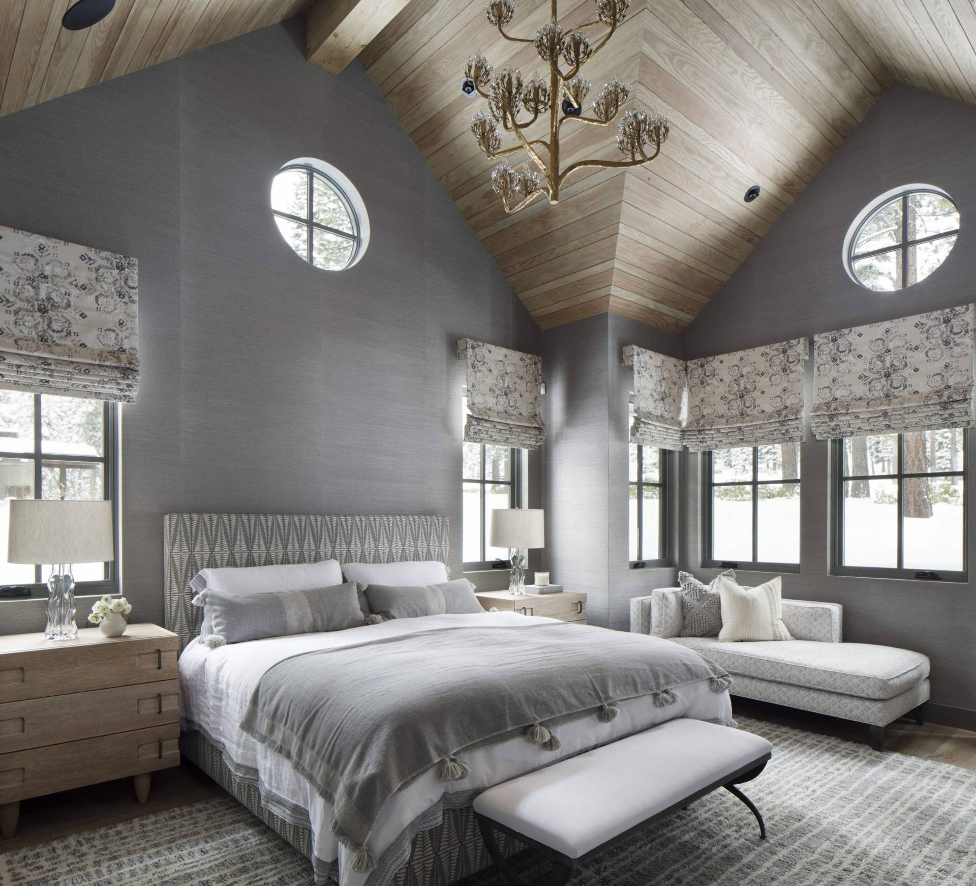 Patterned roman shades, grey upholstered headboard and custom linen bedding