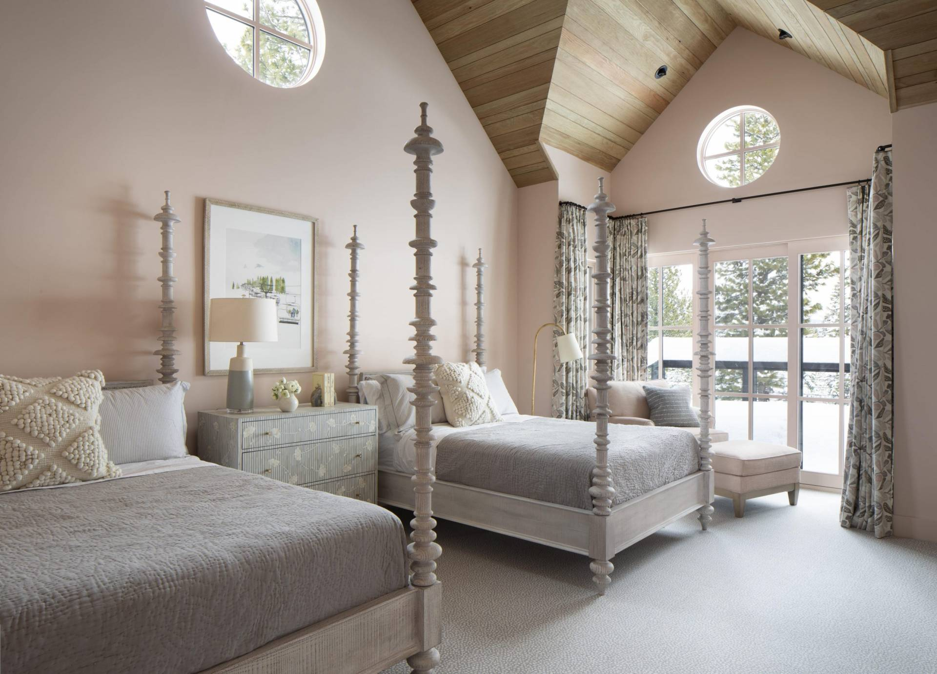 Guest bedroom light and fluffy bedding with printed drapes