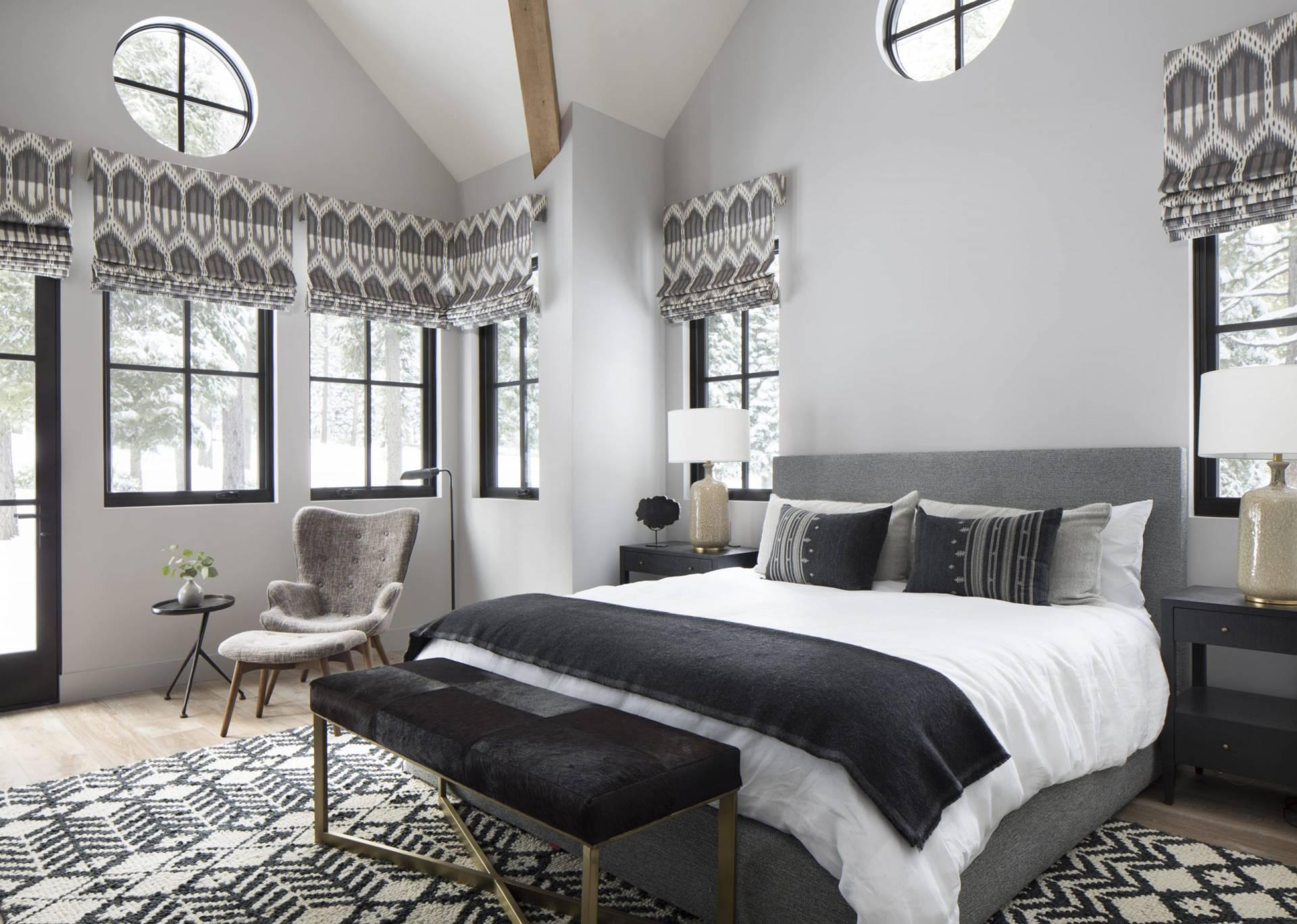 Shades of grey bedroom with roman shades
