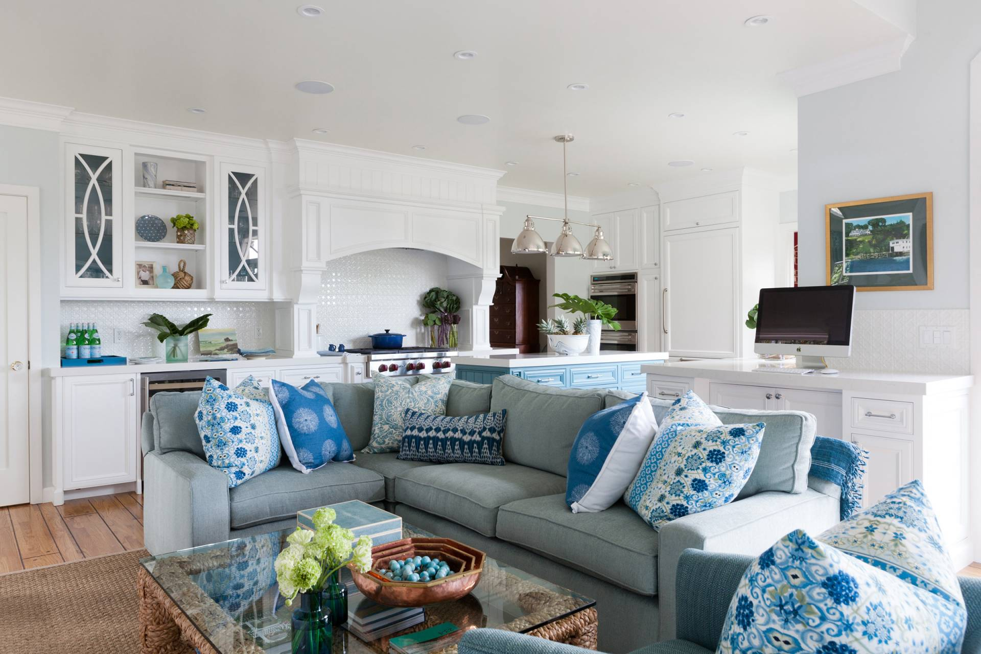 Open floor plan upholstered sofa in kitchen with shams