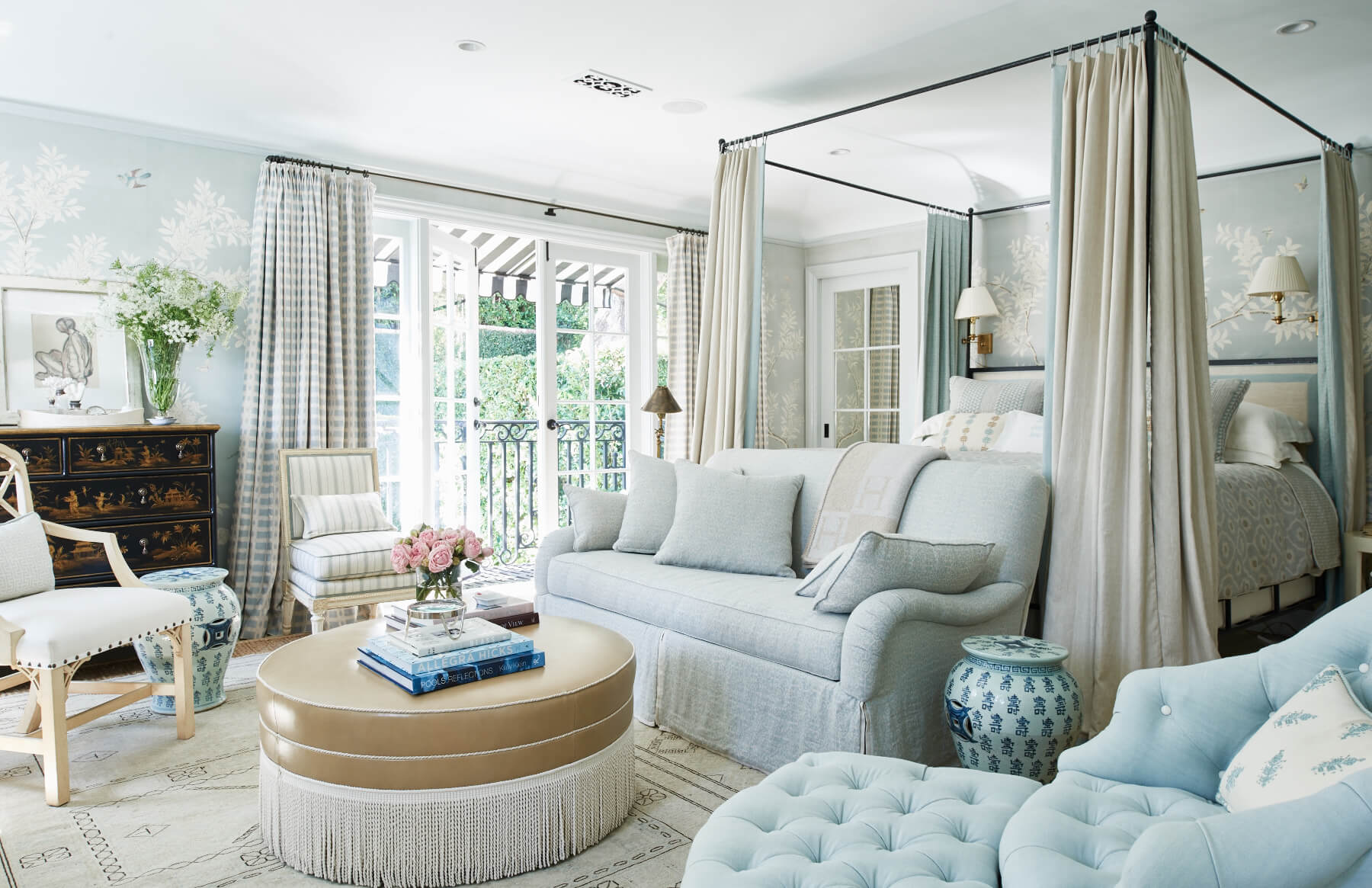 Master bedroom with bed canopy and striped drapes