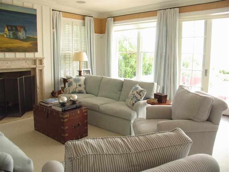 Striped living room sofa with matching curtains