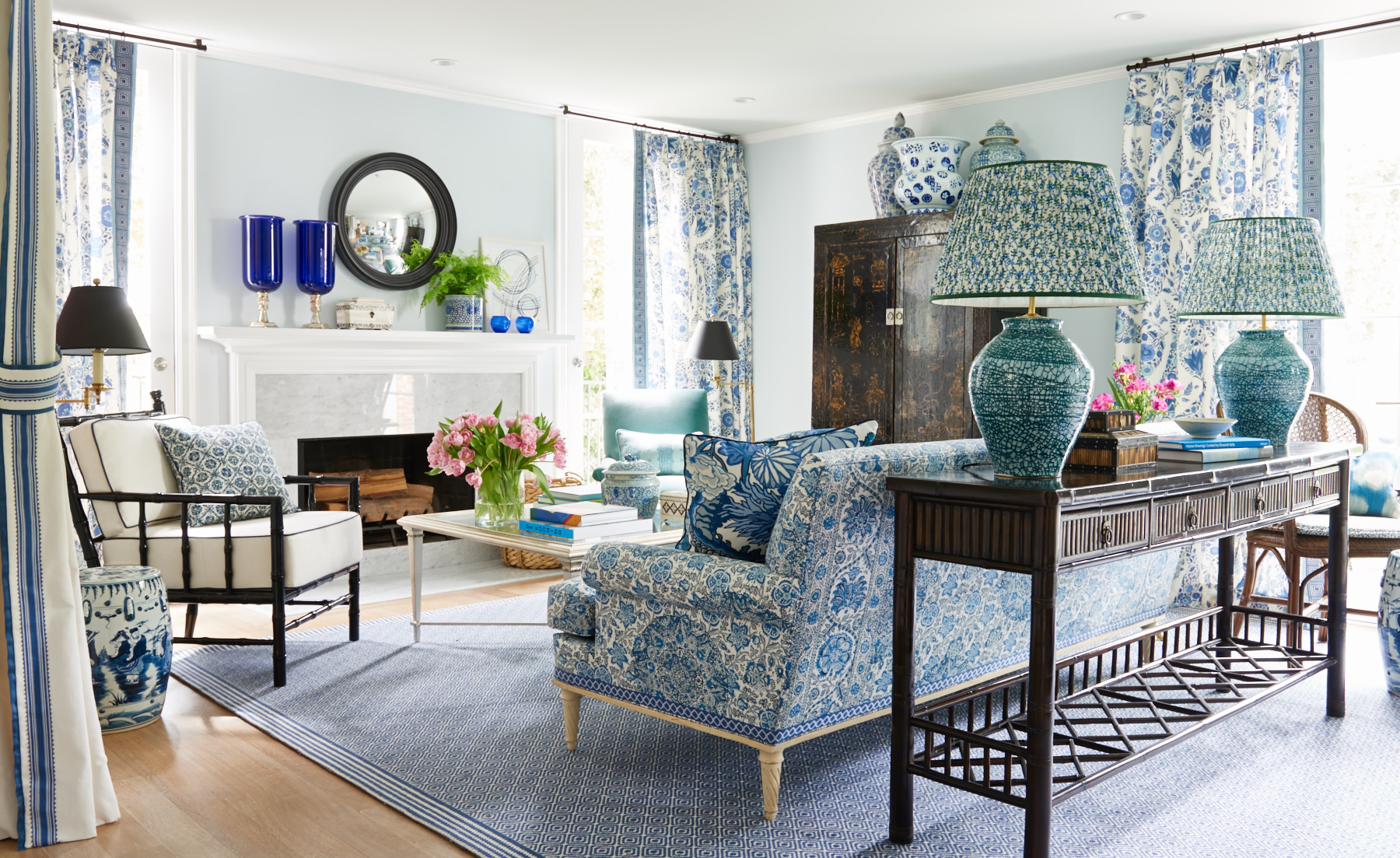 Blue paisley living room with upholstered sofa and sitting chair