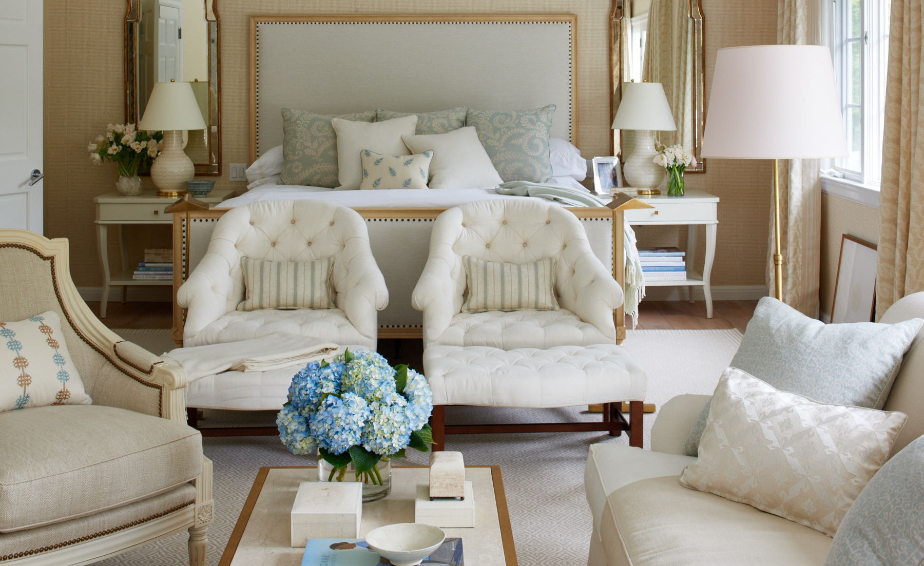 Cream master bedroom with upholstery
