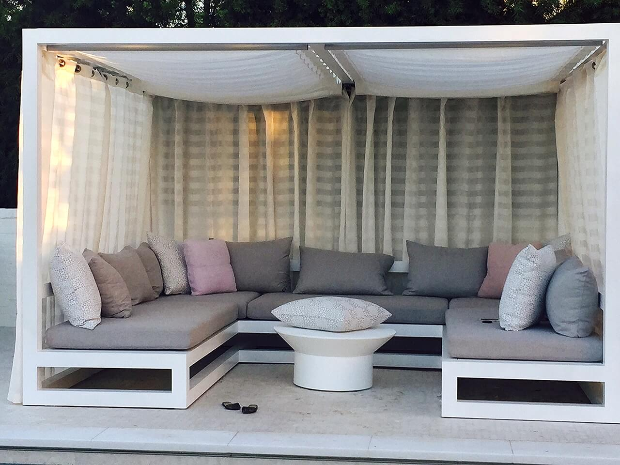 Grey outdoor sofa with cushions