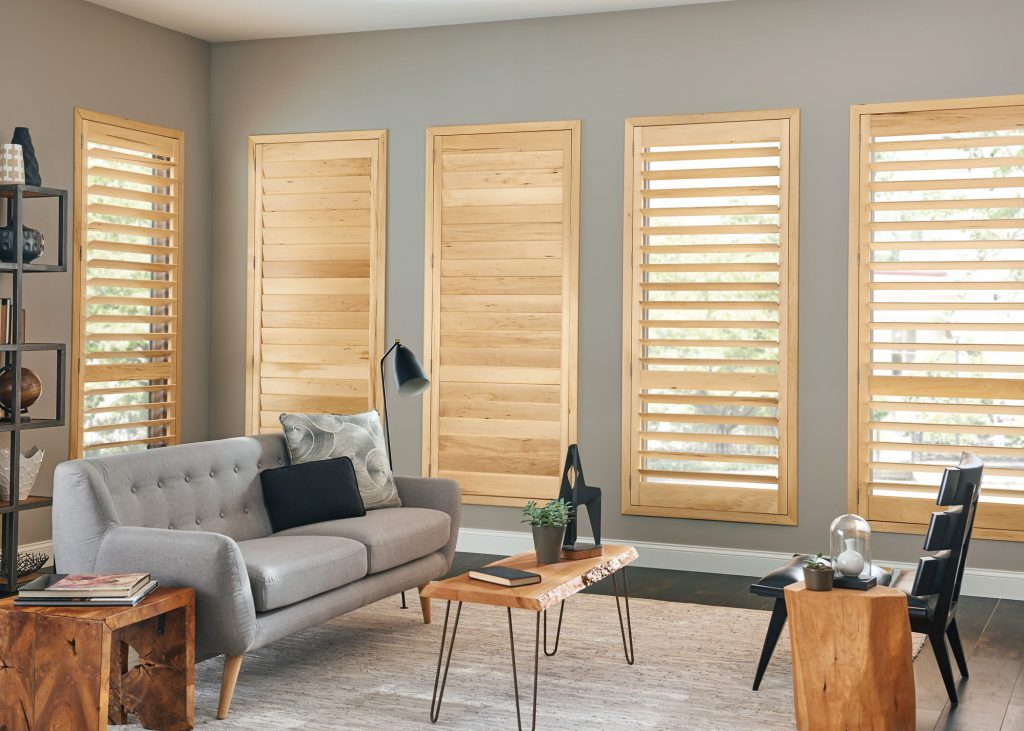 Natural wood living room shutters