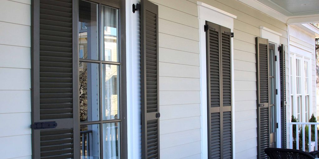 Brown exterior plantation shutters