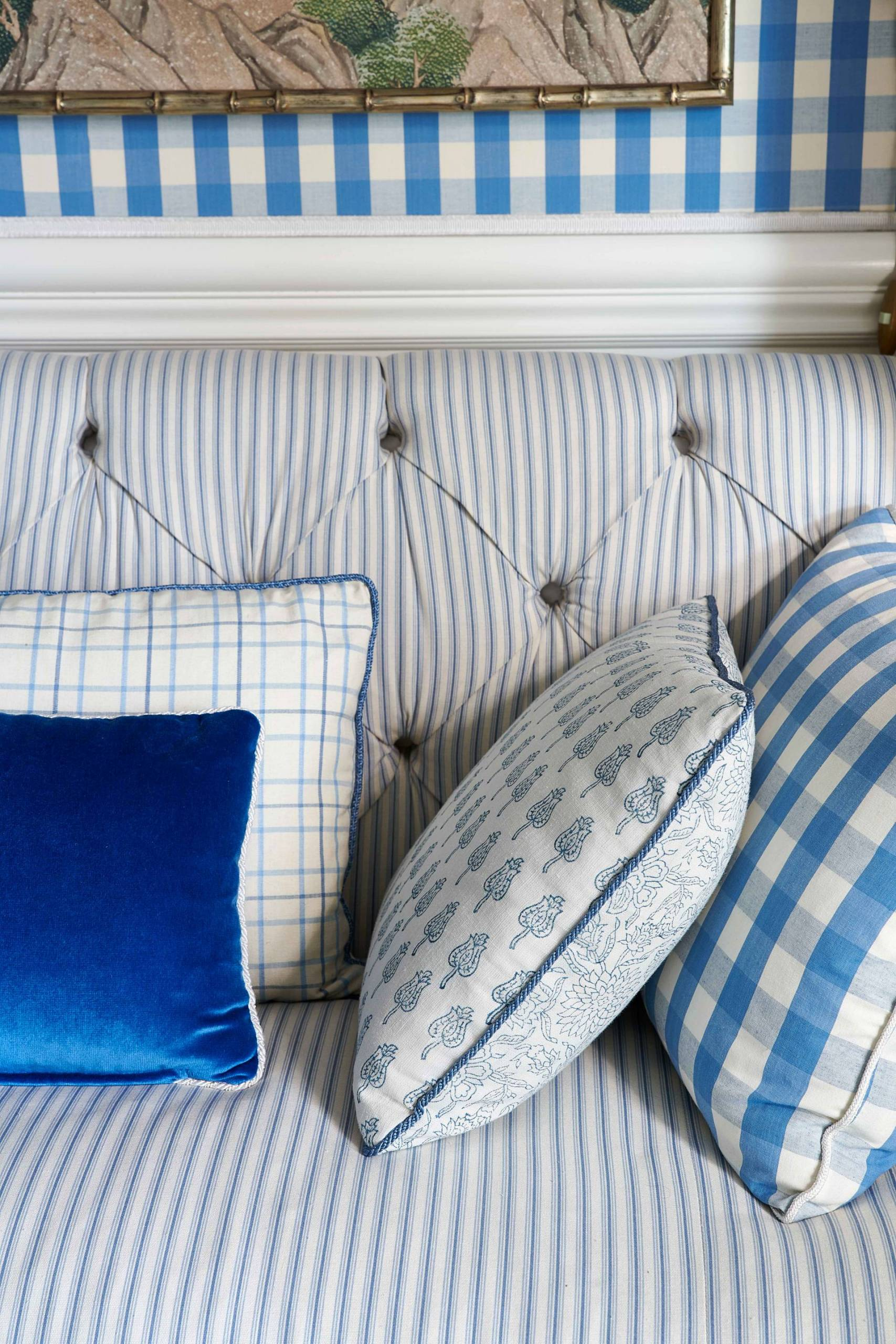 Stripe and Checkered Pillows on Upholstered Bench