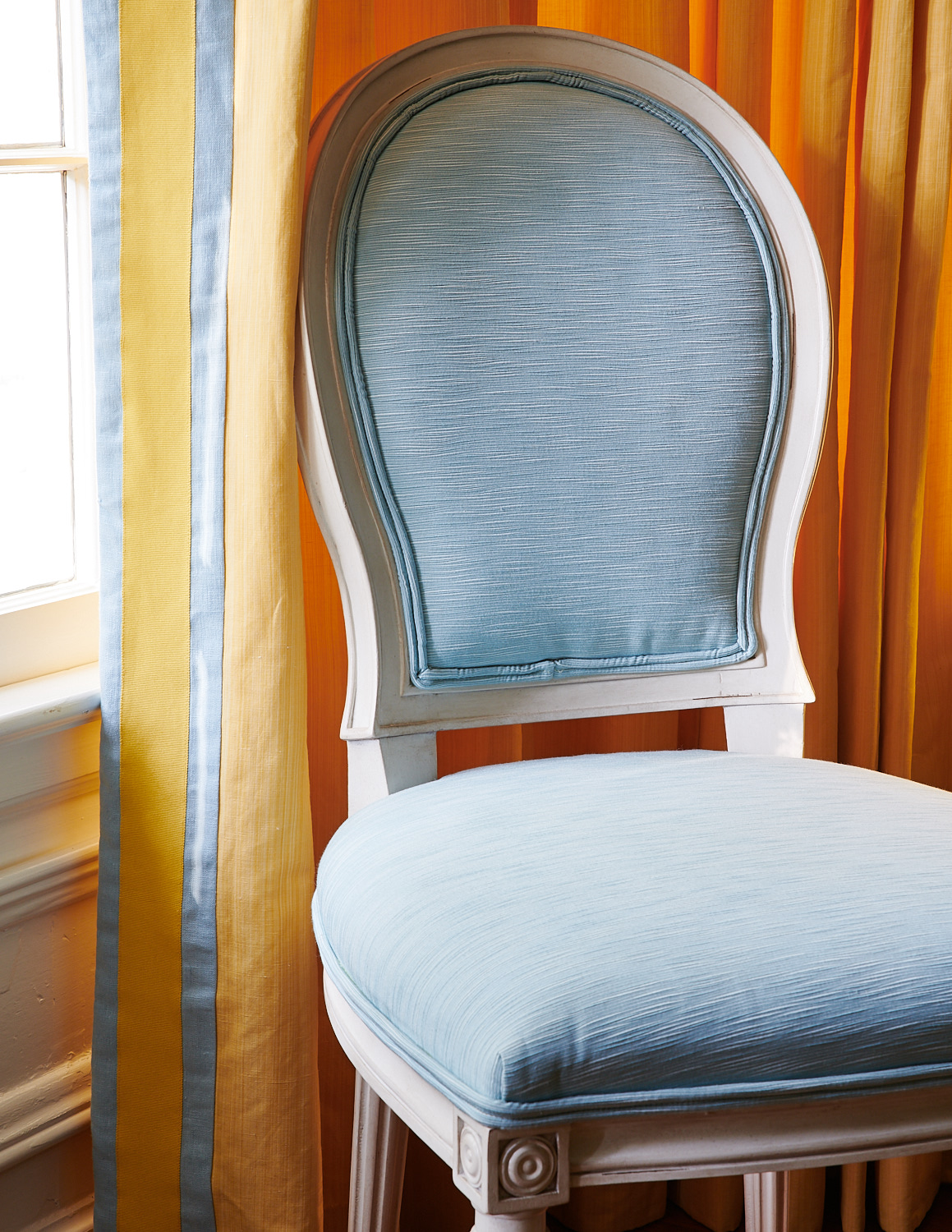Baby blue upholstered dining room chair with matching trim