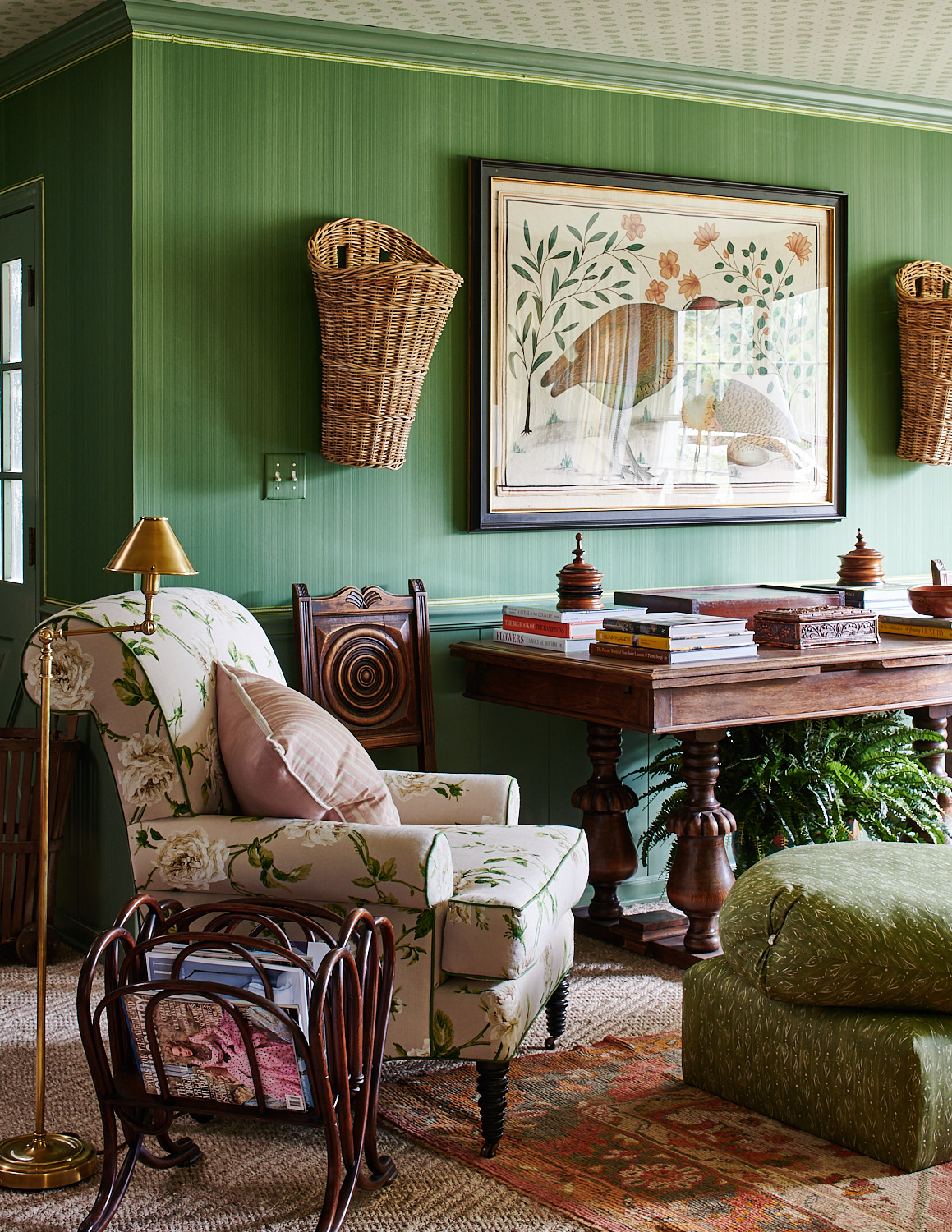 Floral upholstered chair and side-tufted ottoman