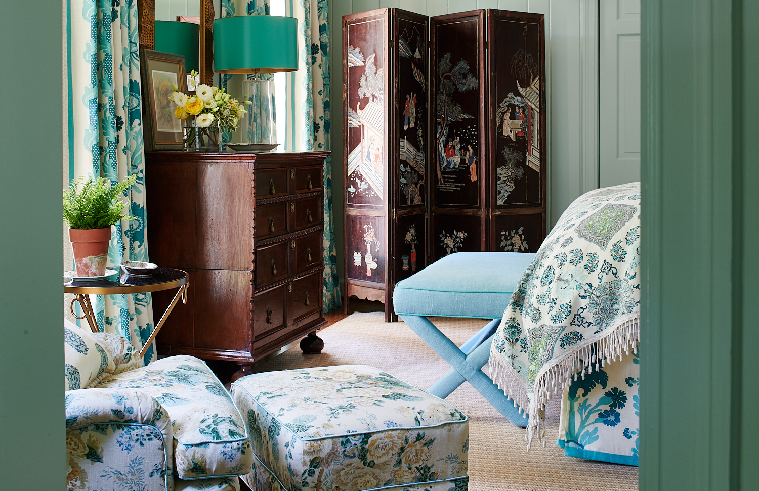 Blackout drapery, upholstered floral chair and matching ottoman, bedskirt, and upholstered bench
