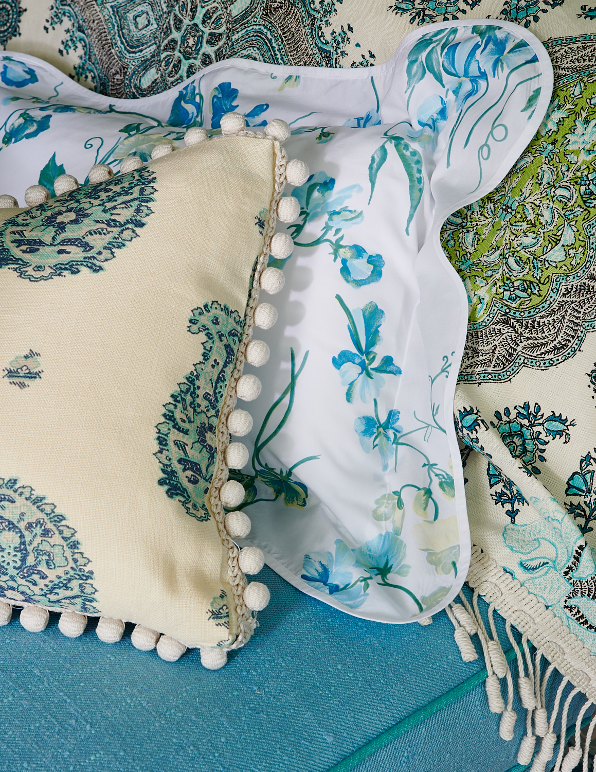 Custom pillows with orb tassels, and floral shams pillows