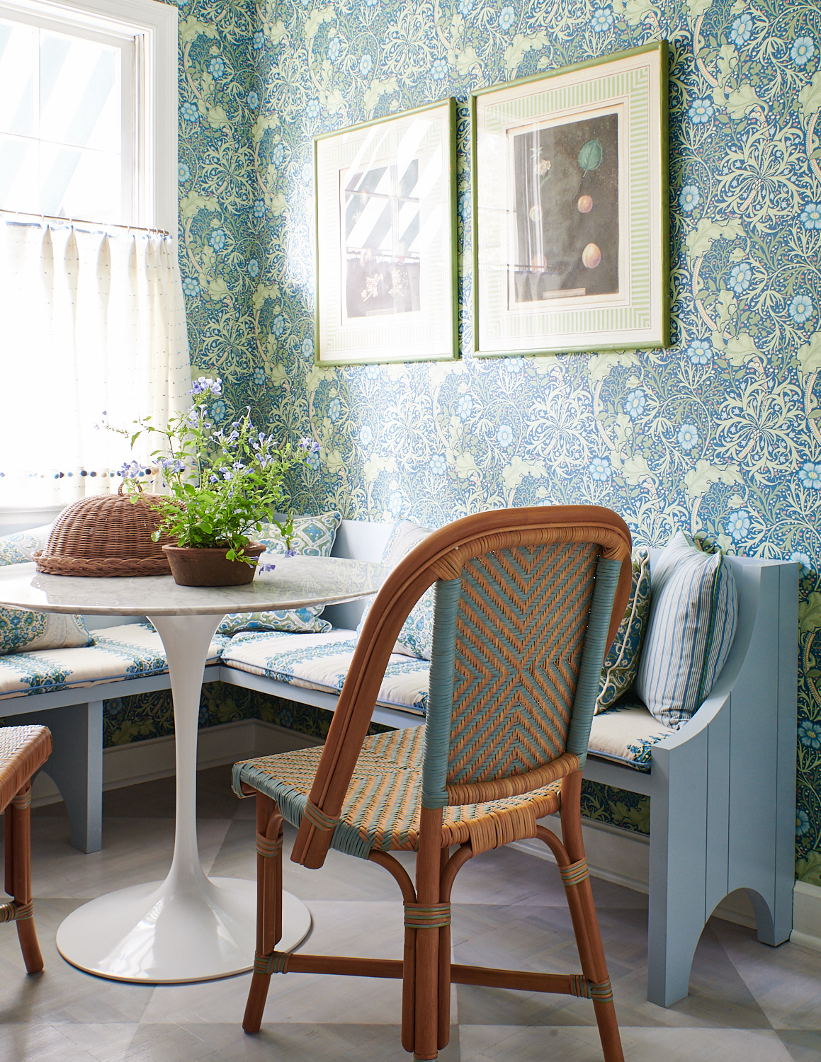 Breakfast nook bench cushions, various throw pillows, and kitchen drapery