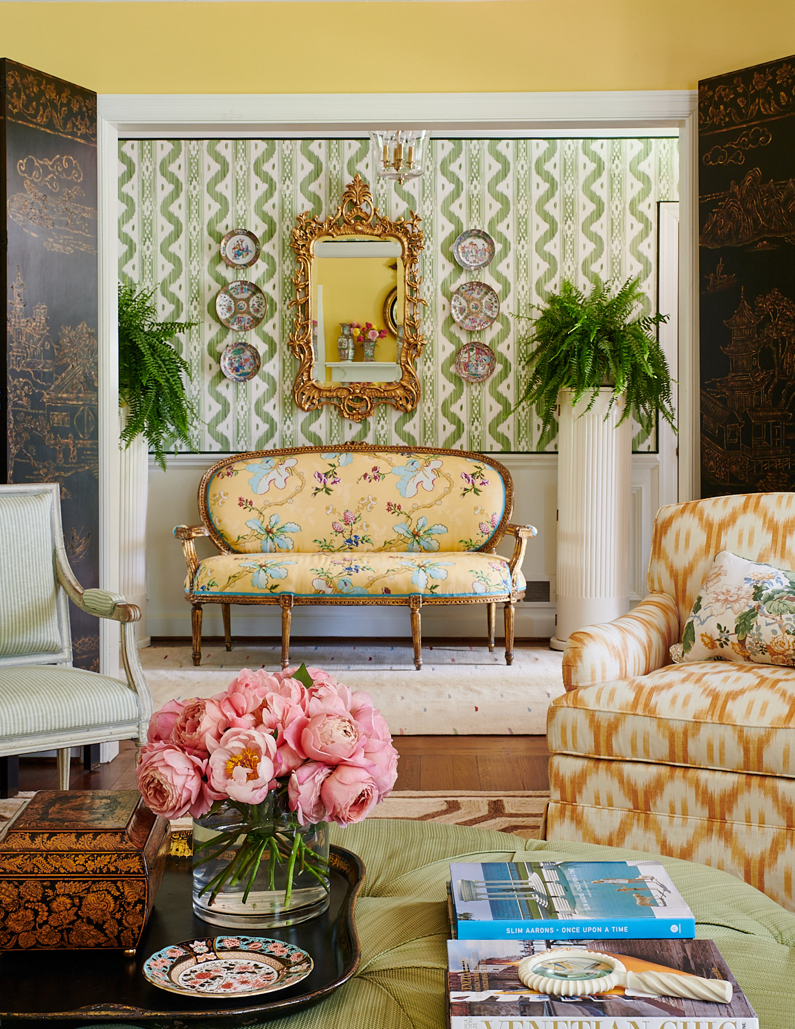 Vibrant floral settee with other upholstered chairs
