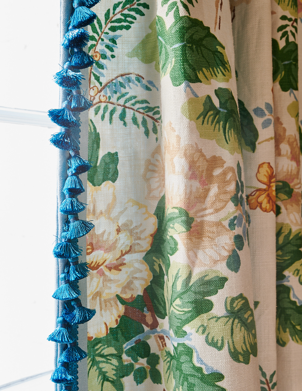 Floral drapery with blue tassels