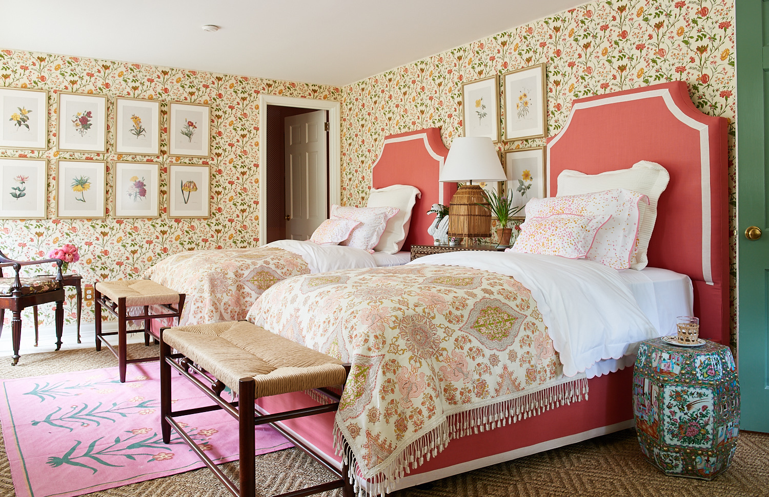 Pink upholstered twin bed headboards with custom shams pillows, and wicker benches