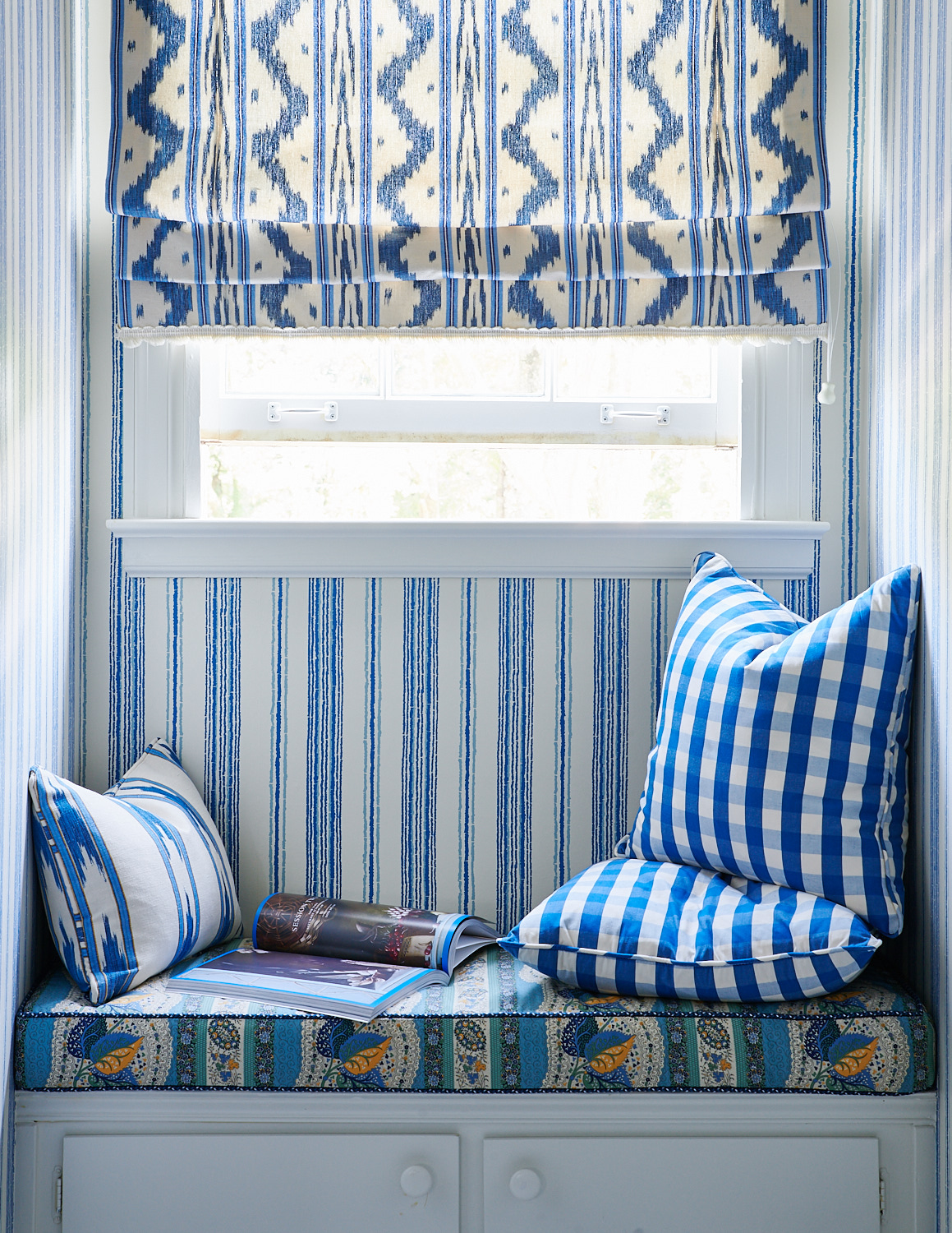 Bedroom roman shades, built-in bench with cushions, and custom throw pillows