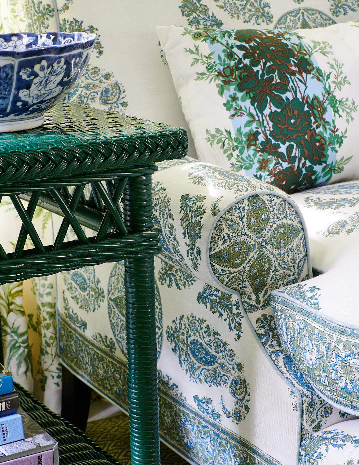 Detail on upholstered chair with trim and kidney pillow