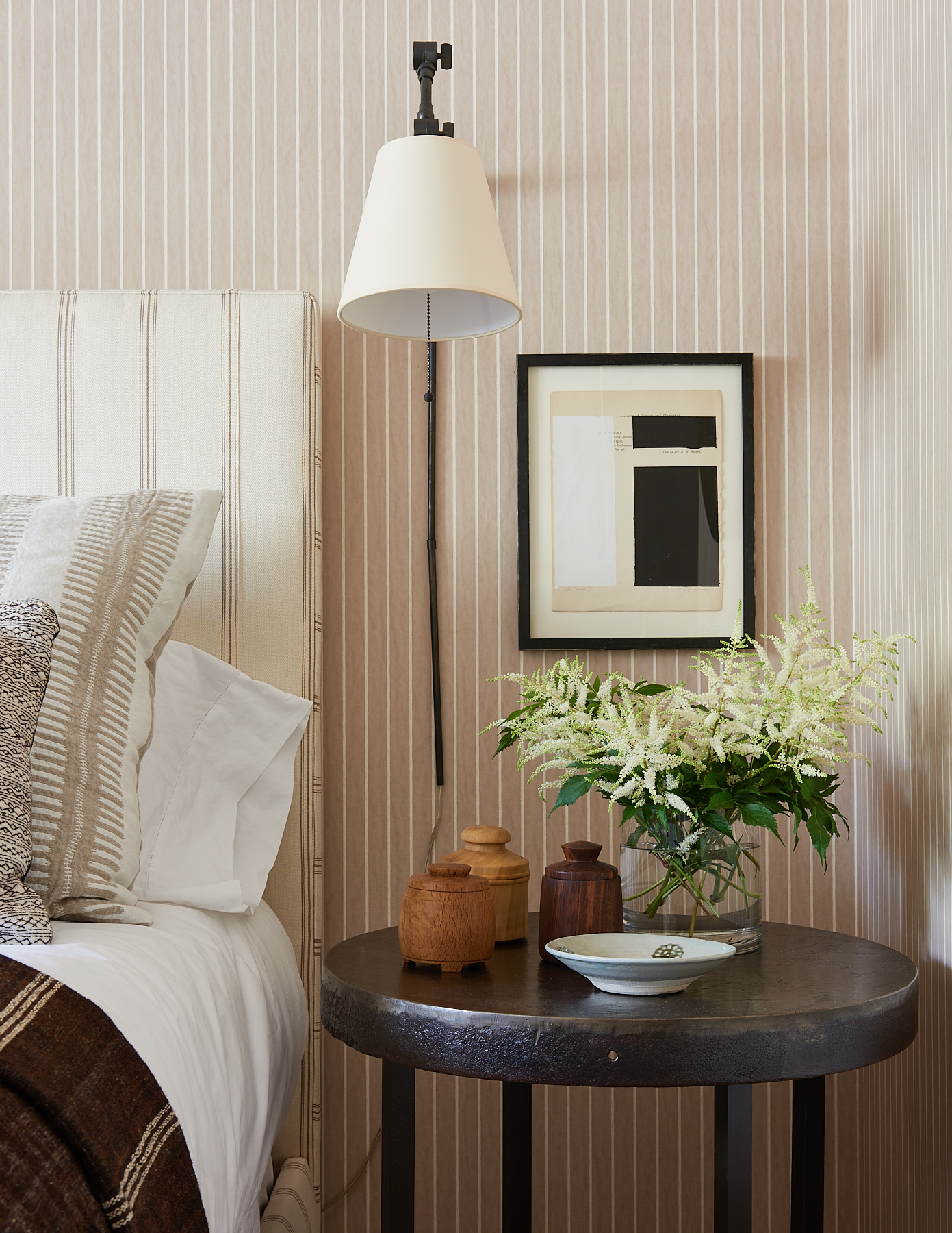Striped headboard with various throw pillows