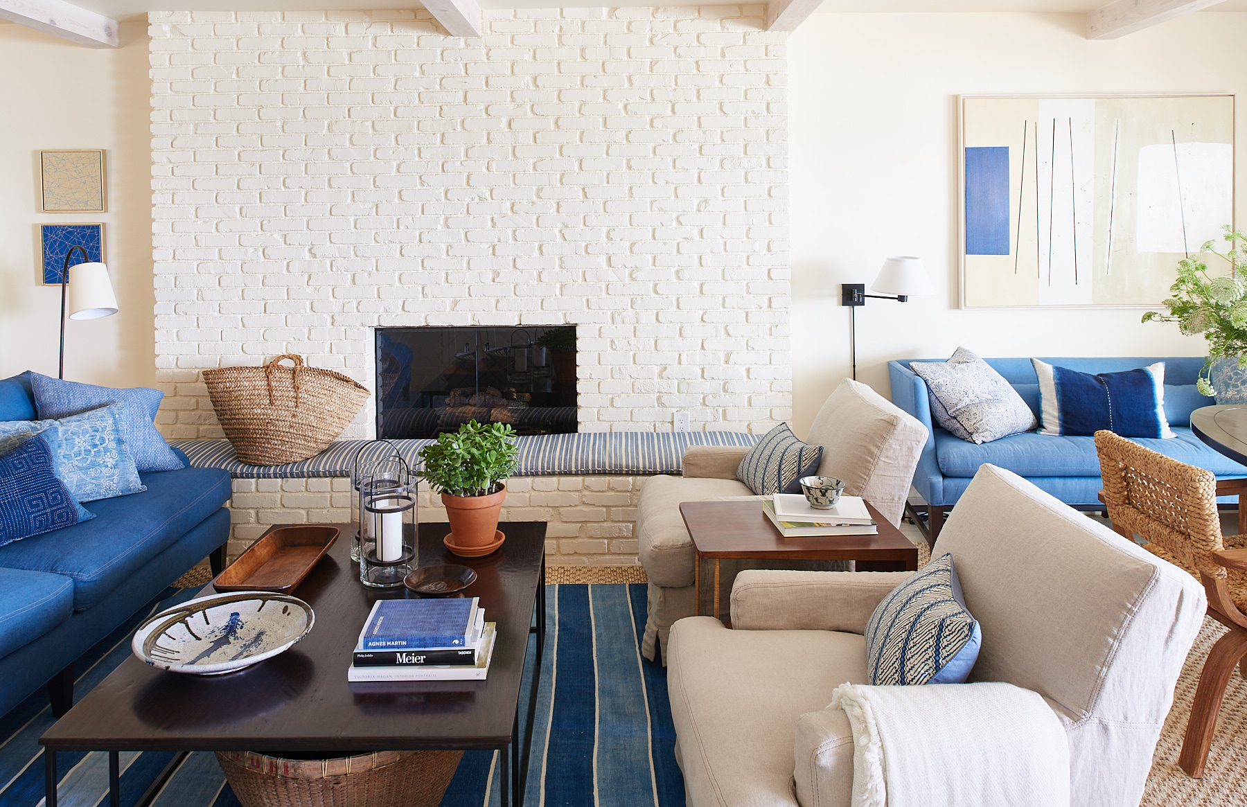 Beige linen club chairs, denim-style sofa, and horizontal-tufted settee.