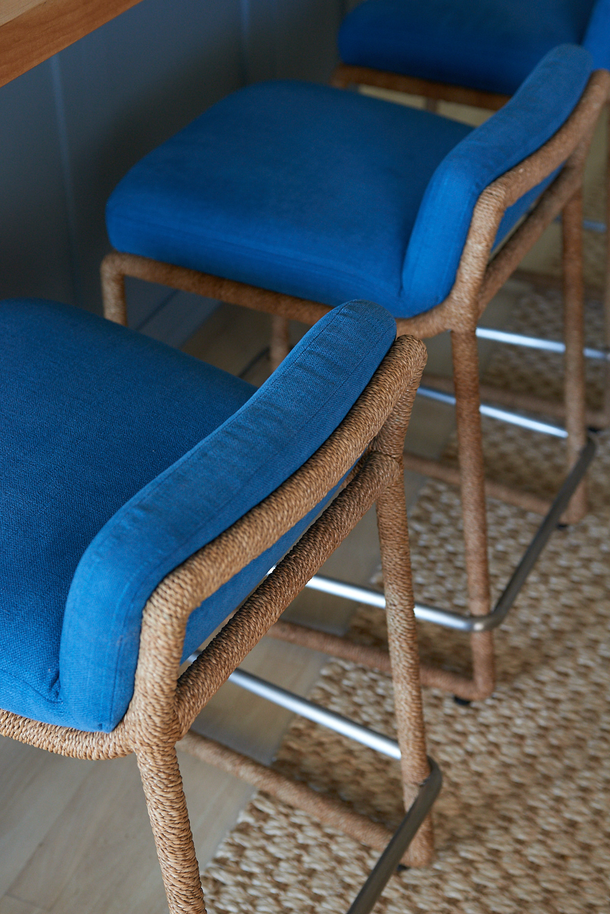 Wicker barstools with blue cushions