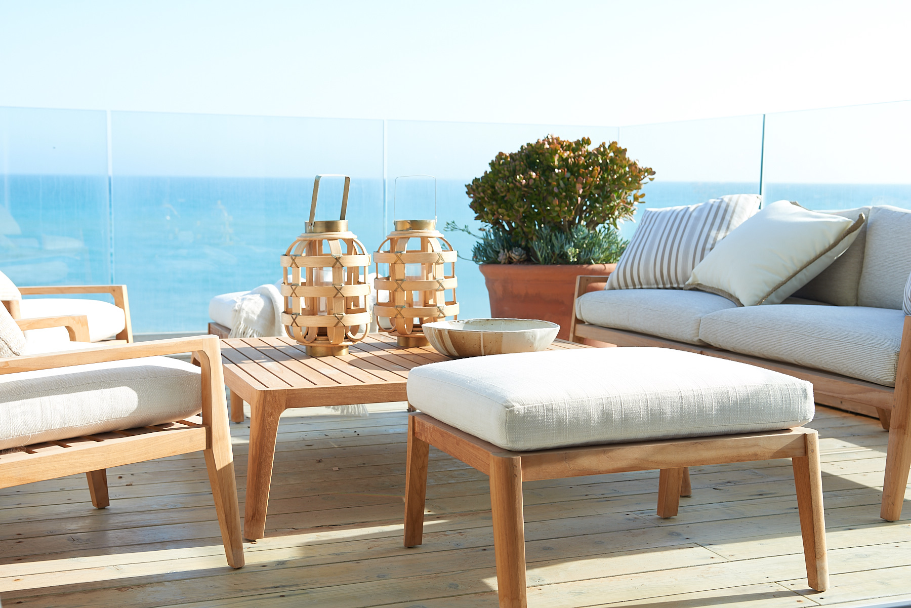 Outdoor patio set with cream-colored cushions