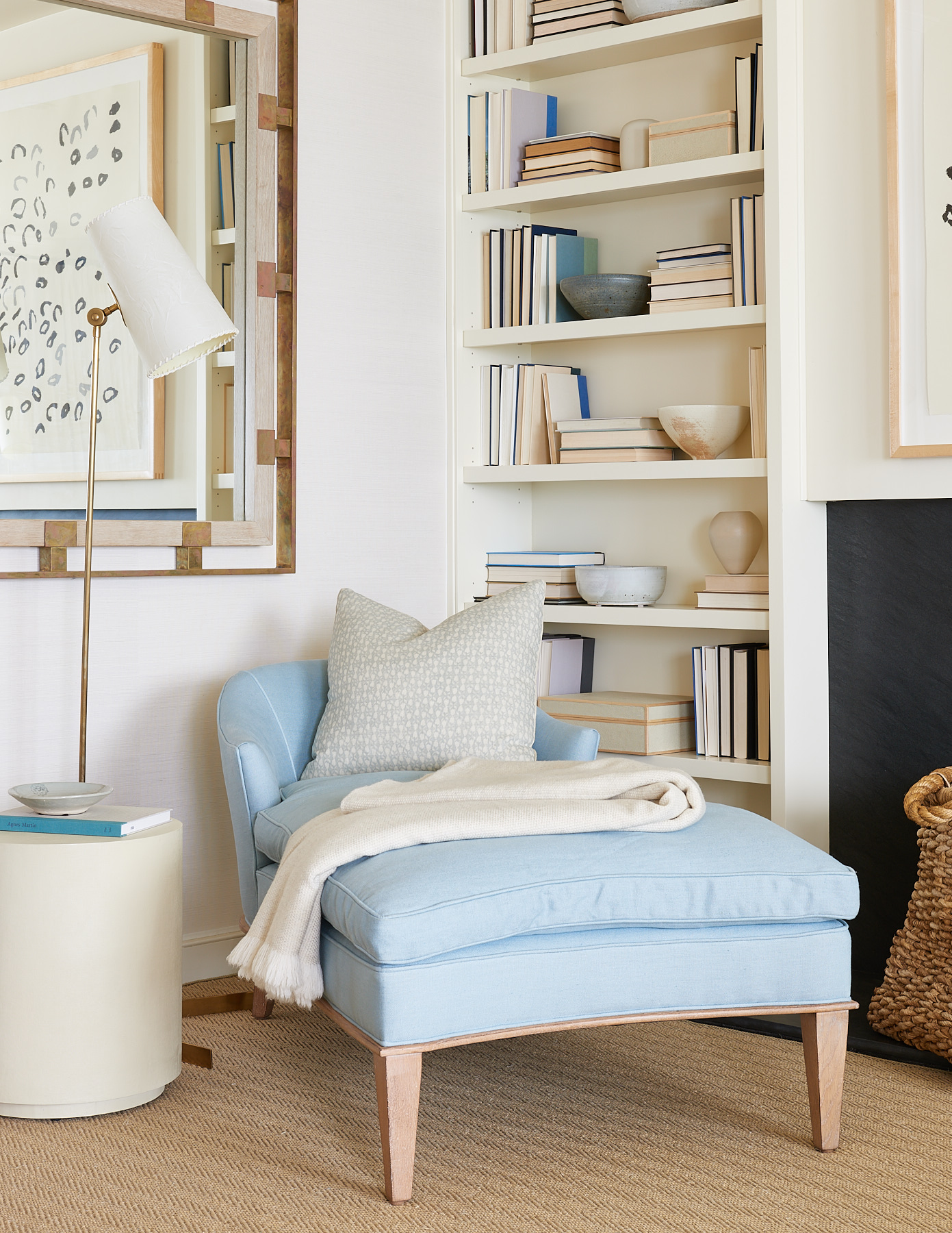 Baby blue chaise lounge and patterned pillow