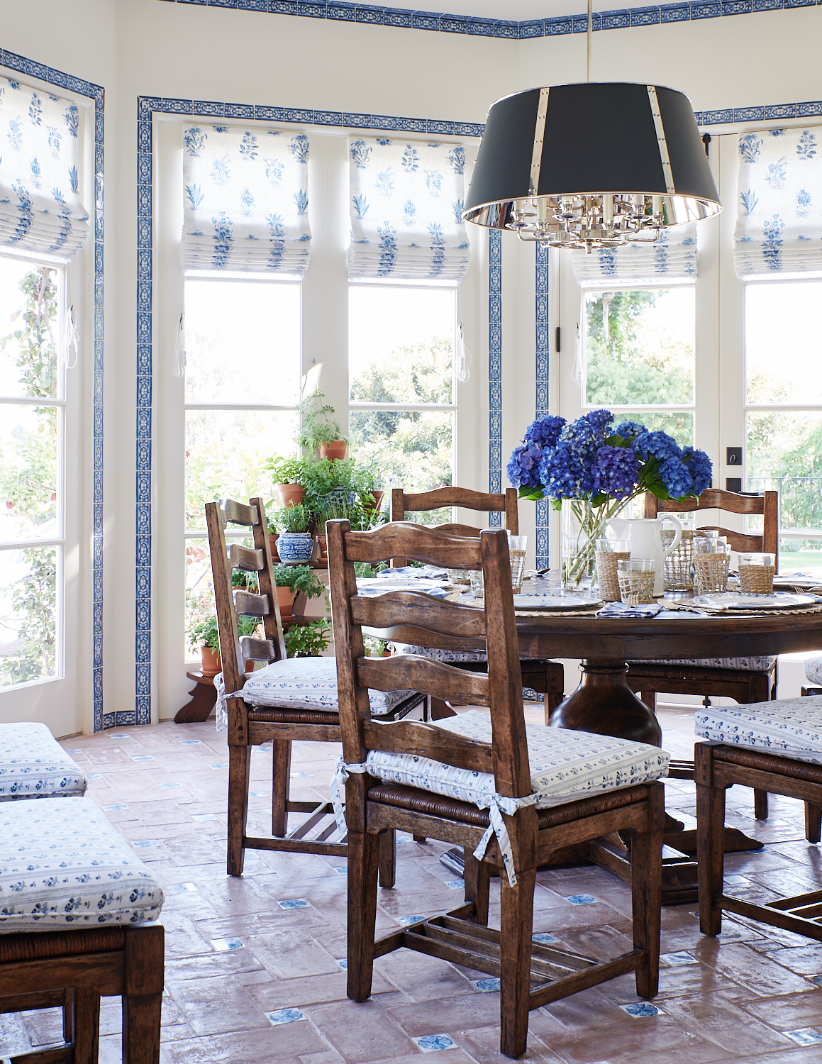 Breakfast nook roman shades and tied banquet cushions