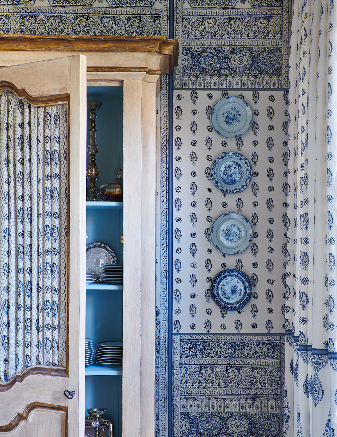 Armoire with paisley-patterned covers