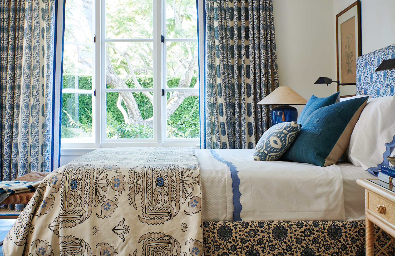 Upholstered bed, custom throw pillows, and window drapery