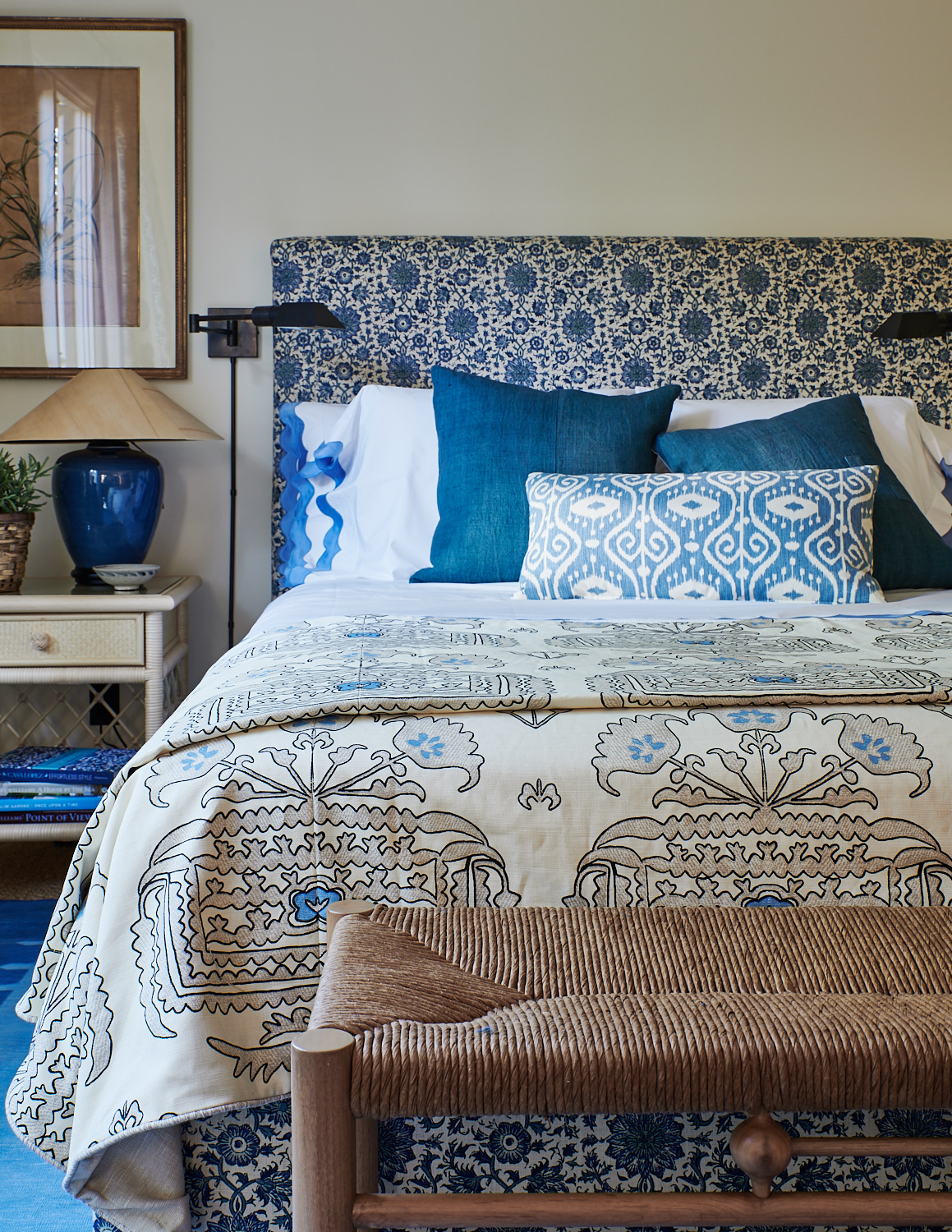 Upholstered bed with custom throw pillows
