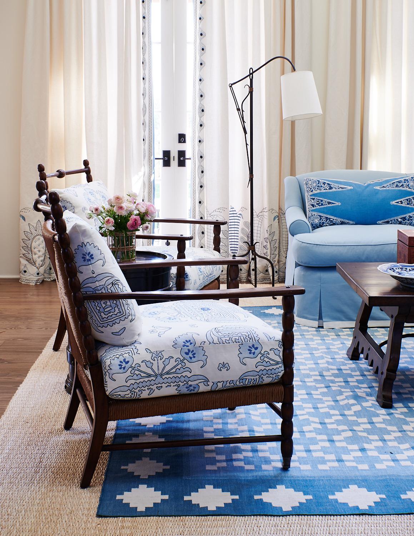 Sofa with skirt, custom cushions on wicker chair