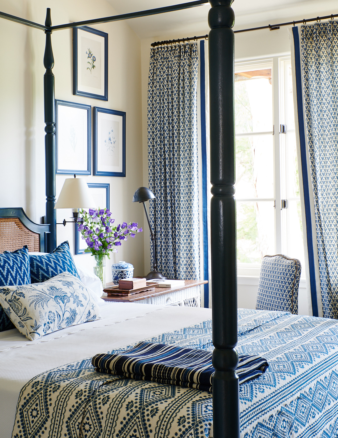 Wicker headboard with custom bed throw pillows, upholstered desk chair and matching blackout drapes