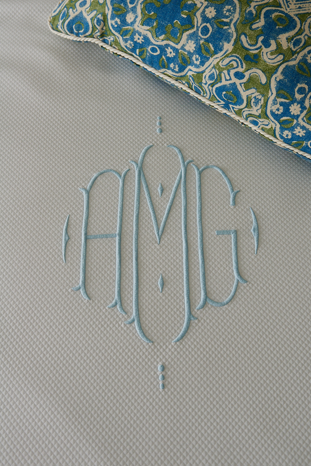 Detail of custom fabric crest and trimmed pillow