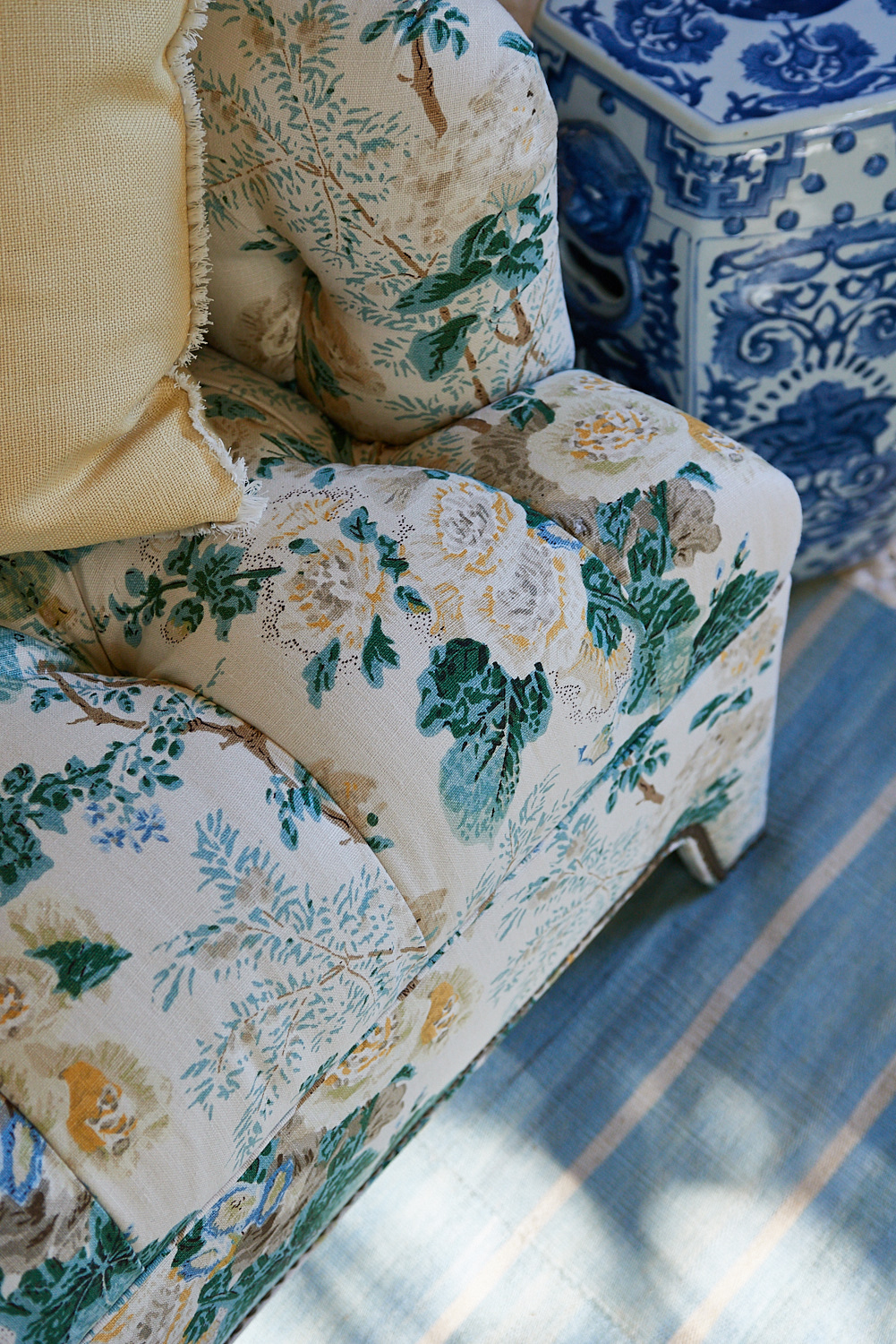 Floral upholstered sofa with rivets